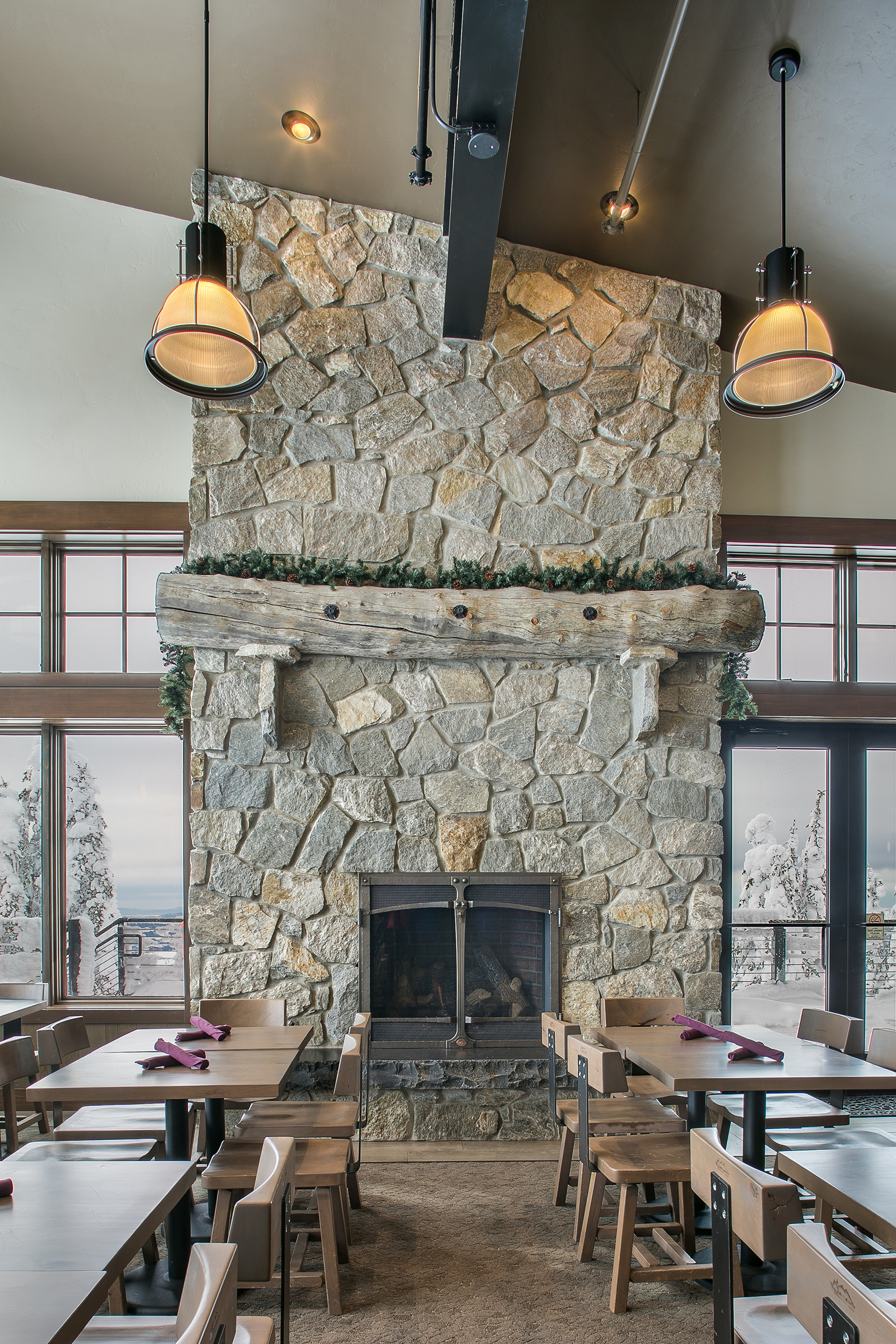 Skyhouse-interior-steel-beams-Schweitzer-Lodge-fireplace.jpg