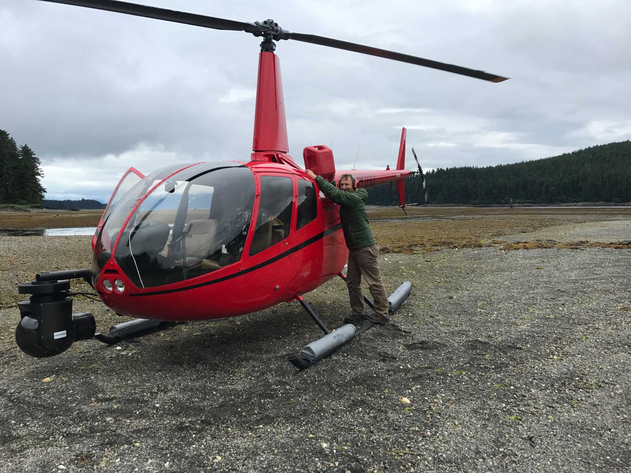 Daniel Zatz with R66 helicopter for aerial footage capture in alaska - Zatzworks Aerial Video