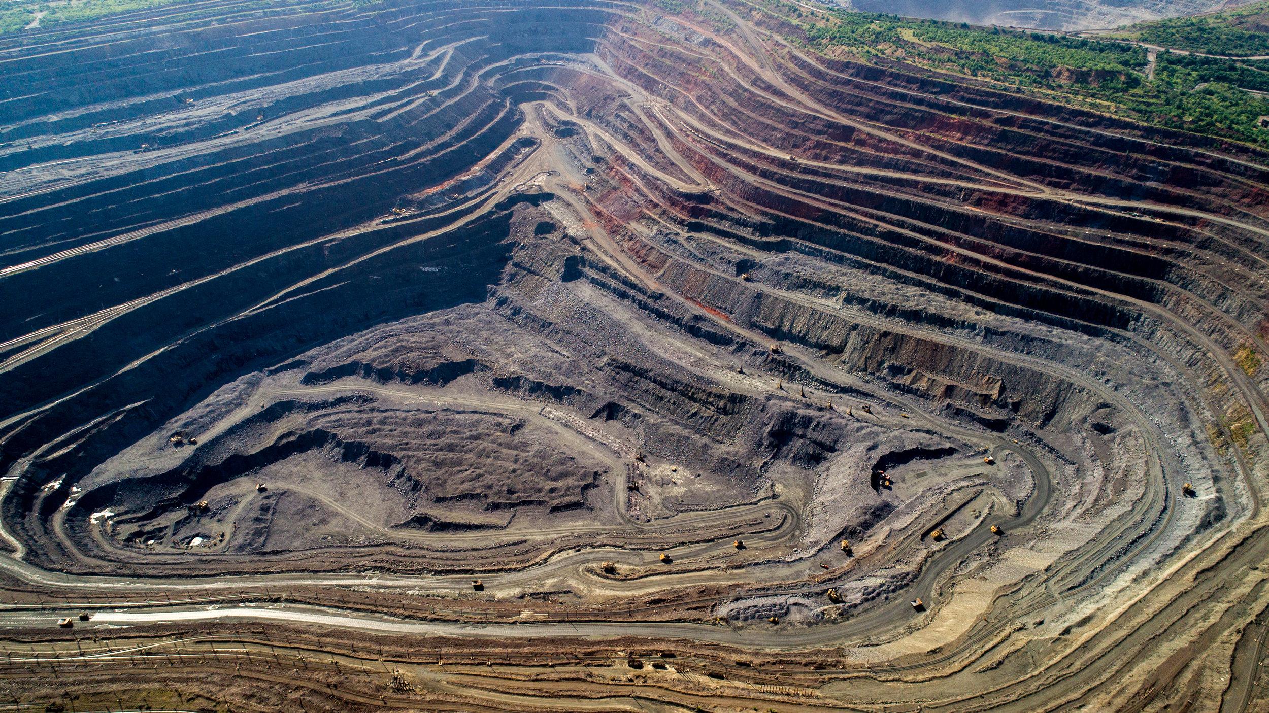 bigstock-Aerial-View-Of-Opencast-Mining-245402191.jpg
