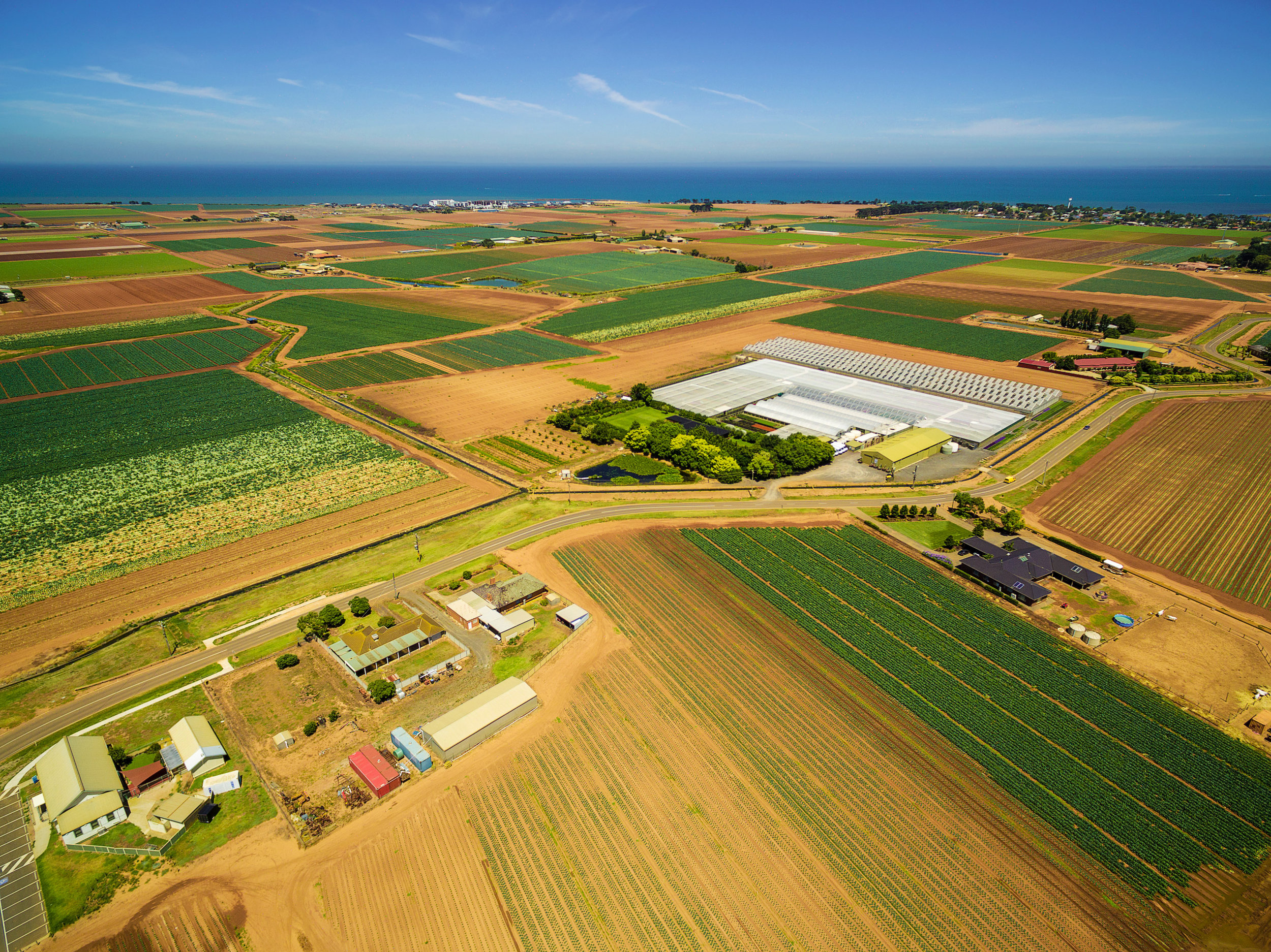 bigstock-Aerial-View-Of-Agricultural-Fi-226688218.jpg