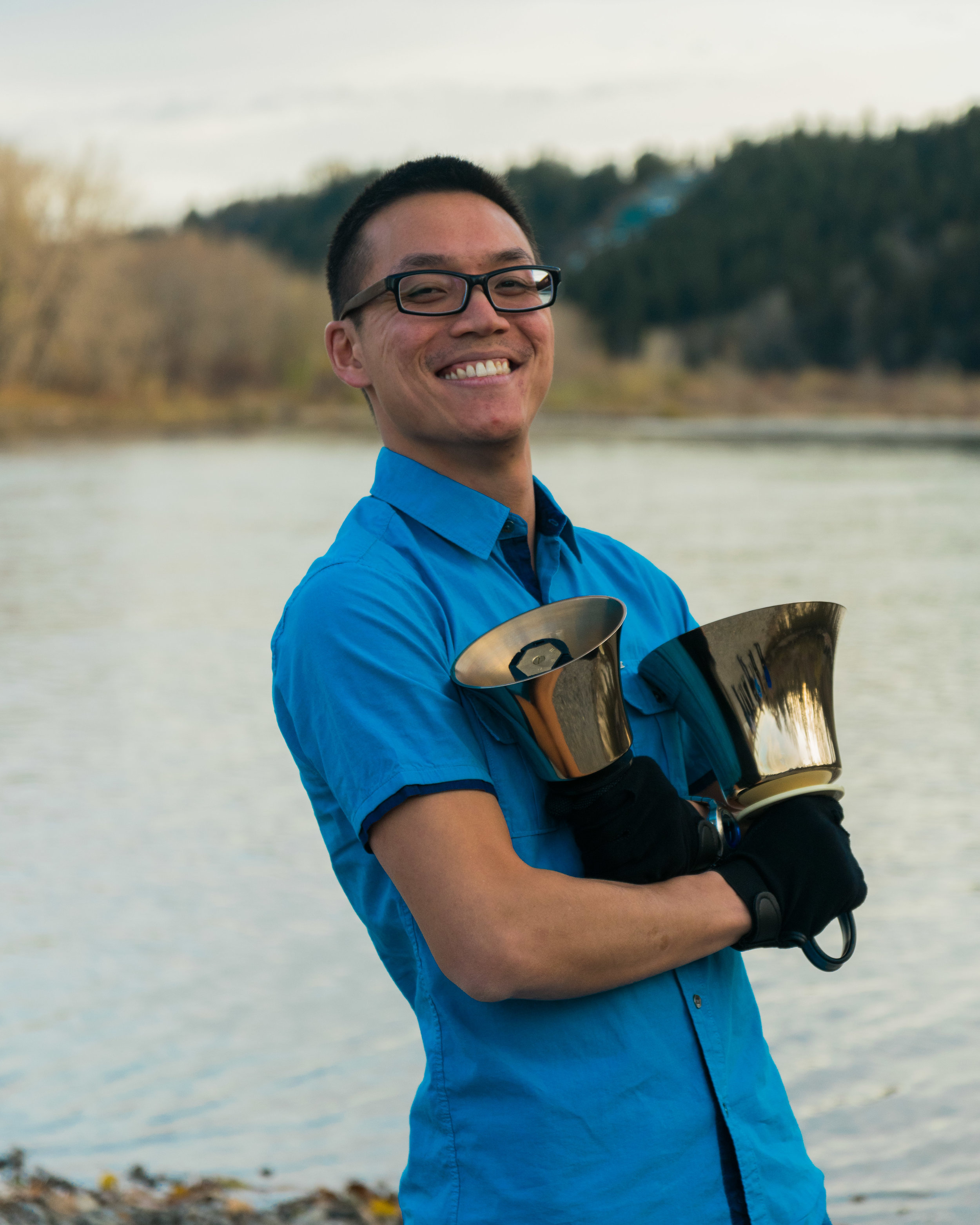 Daniel Chan - My journey with handbells started with my interest in finding a new hobby. Having played the violin for a number of years prior and a brief stint with the Mt. Royal Youth Orchestra, I felt that it was time to try something new. Having no idea what to type in the google search bar, I put in 'bell ringing.' That led me to something completely different! (think hunchback of Notre Dame) Having refined my search to 'handbell ringing', it brought me to a beginner hand bell group -- the one known today as Bell Époque. While ringing in this group for almost a year, I was challenged to go further with my bell ringing -- and that led me to where I am today! I am very glad to be ringing and learning with many experienced ringers in the group and I look forward to what comes next!
