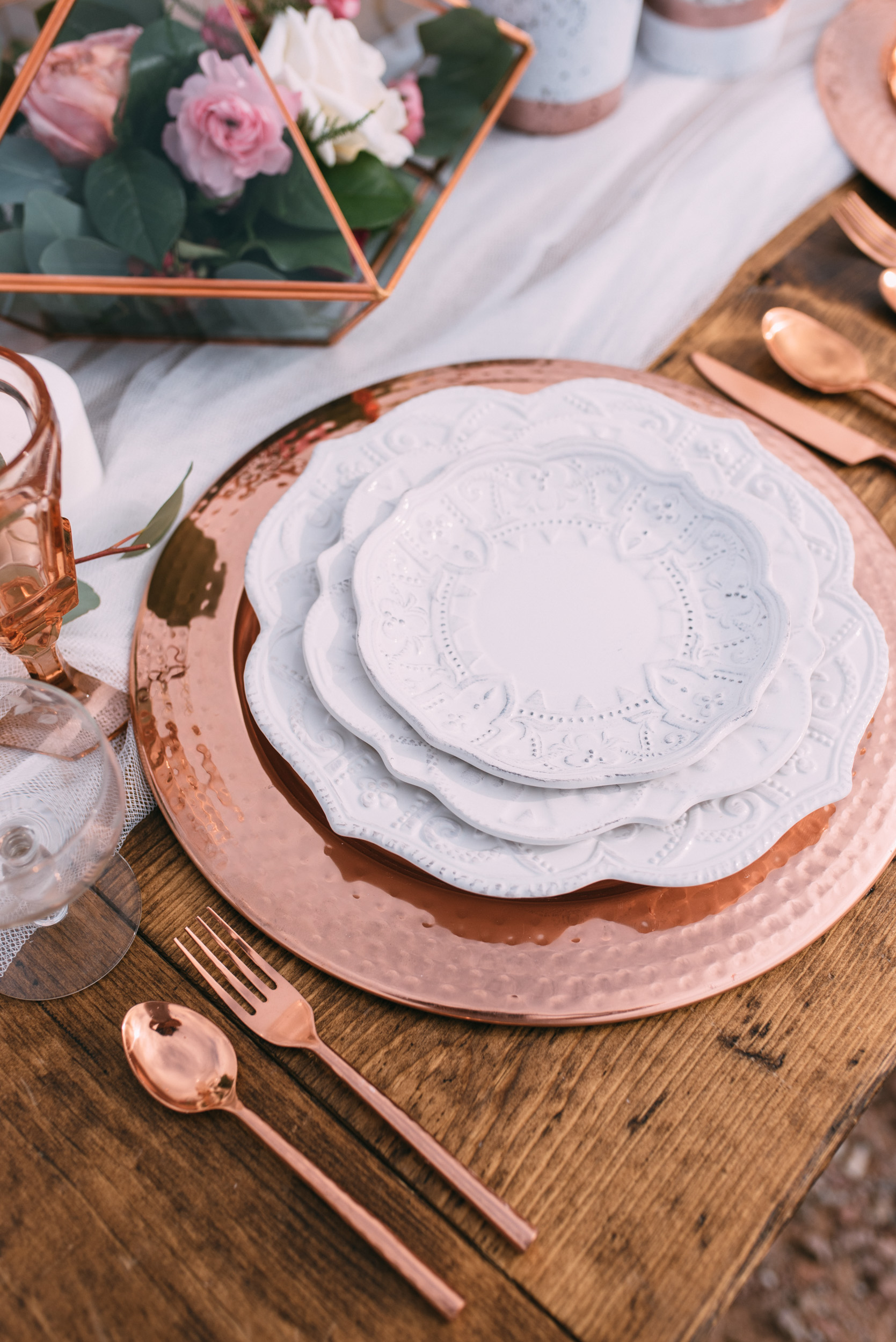 White and copper place setting for wedding wth copper utensils