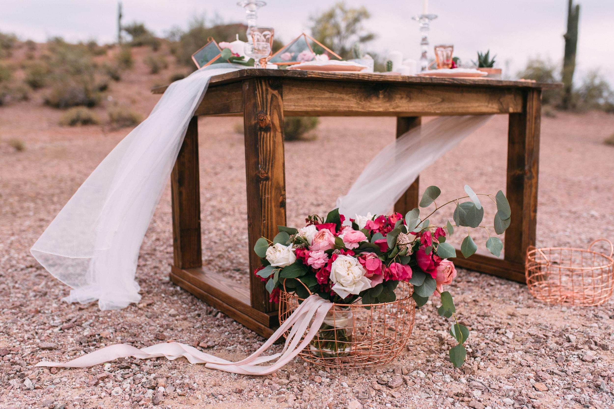 Rustic farm table with wedding bouquet in arizona