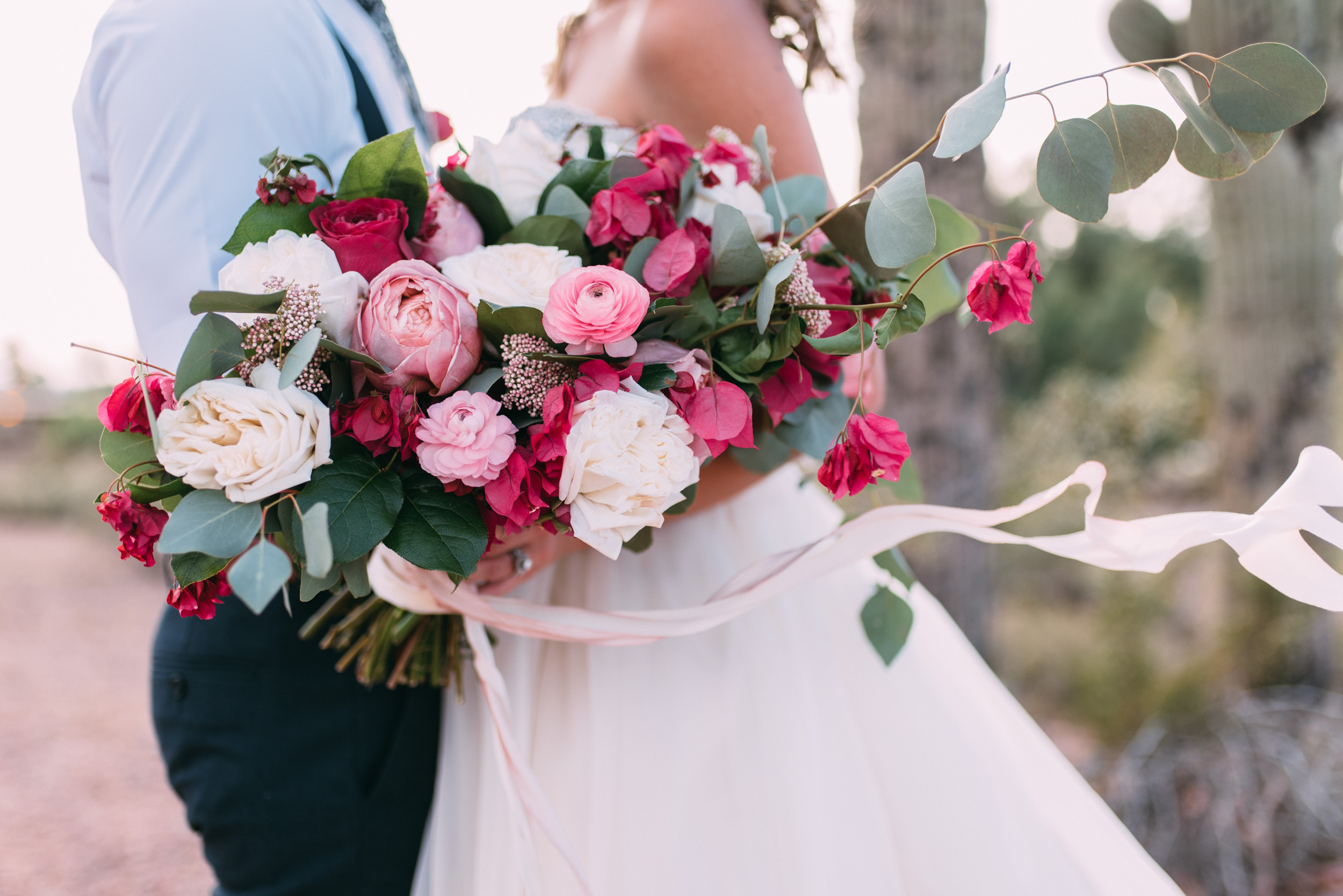 Lush blush, pink and white wedding bouquet with ribbon
