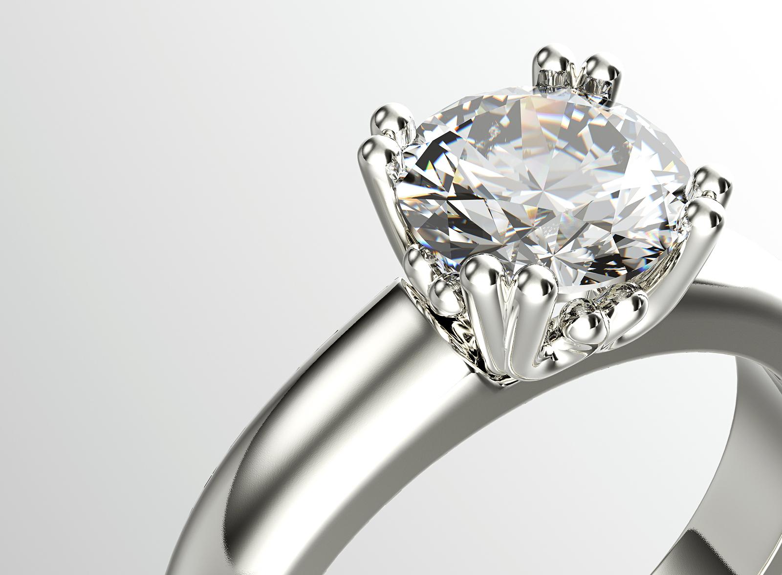 bigstock-Golden-Ring-with-Diamond-Jewe-82870277.jpg