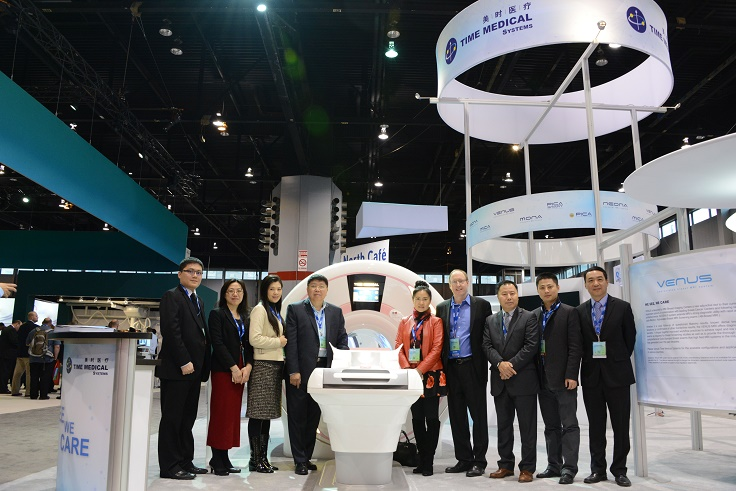 Team Time Medical Systems and Dr. Chris Comstock of Memorial Sloan-Kettering Cancer Center at RSNA 2015 in front of the AB-Breast MRI System