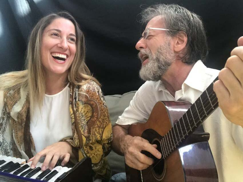Lindsey DePeri and Rick Franz celebrating with music