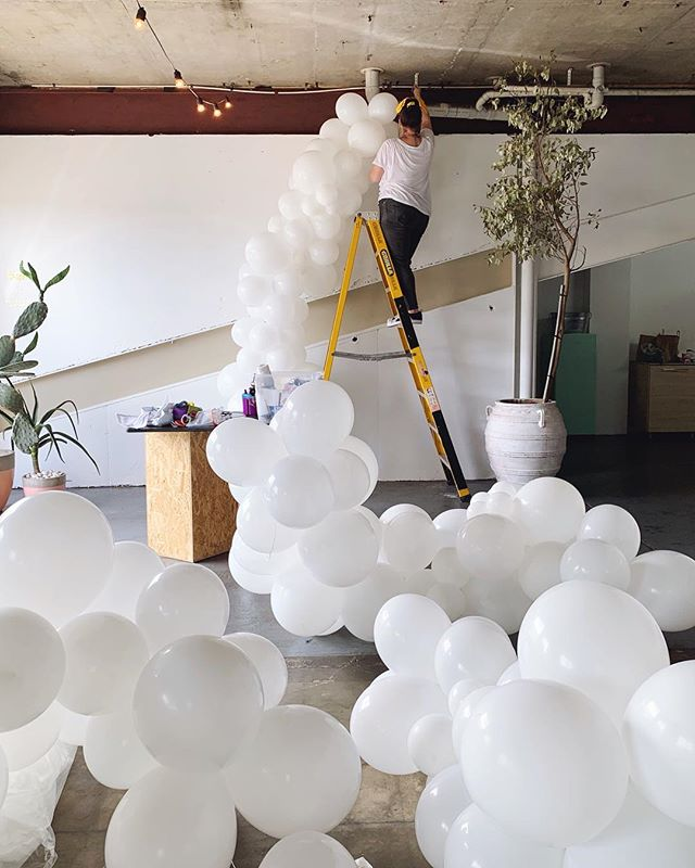 """• B E H I N D  T H E  S C E N E S • Or should that be """"up the ladder""""? Rare footage of our head balloon slinger @likeomg in her happy place - at the top of a ladder, wrangling a cloud of balloons for @the_ware_studio.  Wish we could say the ladder/hairscarf coordination was on purpose but this time it was just a happy accident. Thanks for the pic @themakehaus_, please come be the PS Instagram wifey anytime! ✨❤️🎈 • • • • • #balloondecor #balloongarland #ballooninstallation #partystyling #qualatex #organicballoons #balloonstylist #partyballoons #globos #partyinspo #partyinspiration #weddingballoons #balloonssydney #sydneyballoons #karaspartyideas #eventstyle #sydneyevents #ohitsperfect #theeventcollectivex #flashesofdelight #dscolor #balloonmagazine #abmlifeisbeautiful #BTS #behindthescenes #pursuepretty #flashesofdelight  #myeventstylist #everydayIBT"""