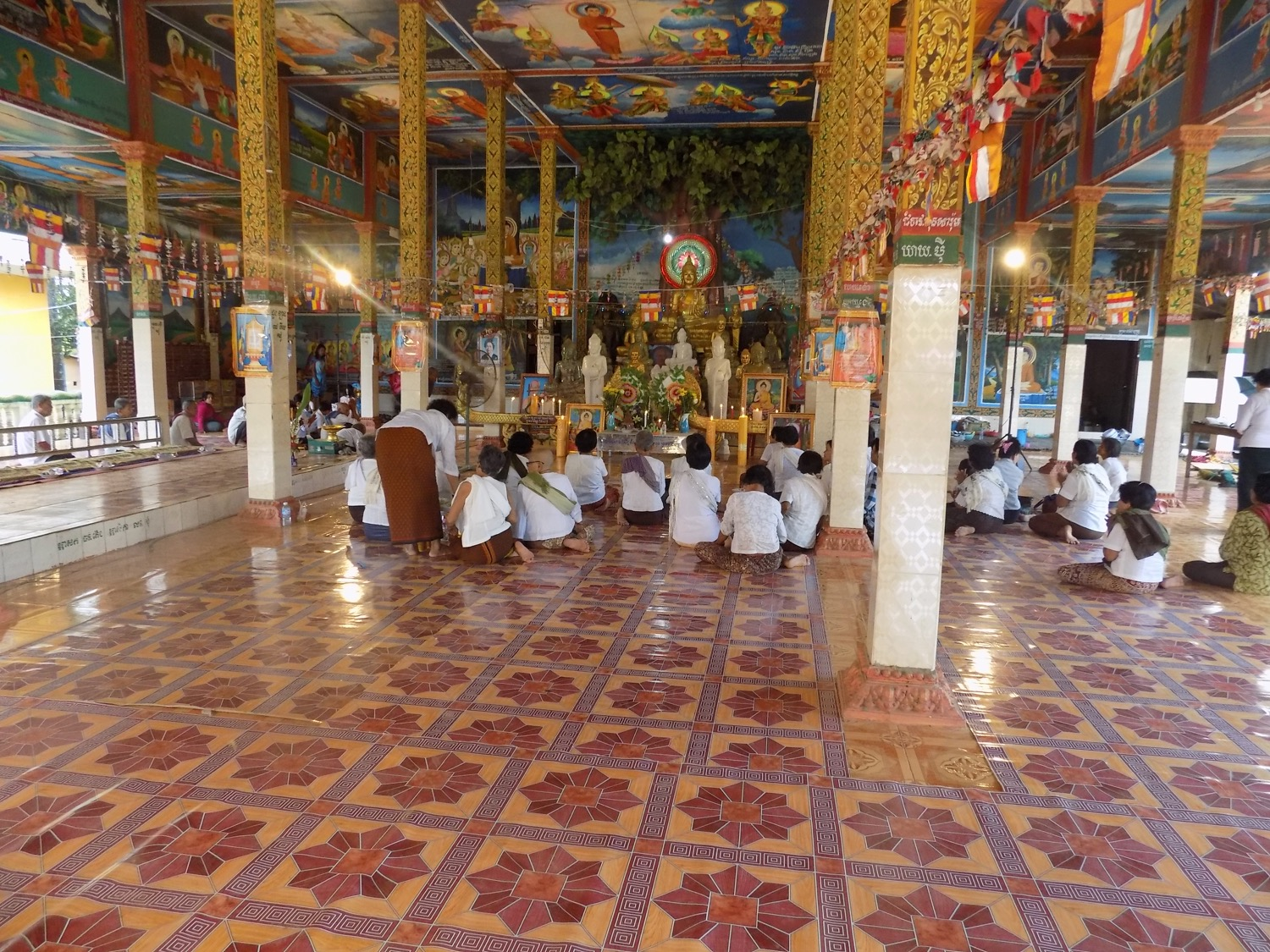 Sometimes after school in the morning, Narak goes to the pagoda to pray or to see some of his friends perform.