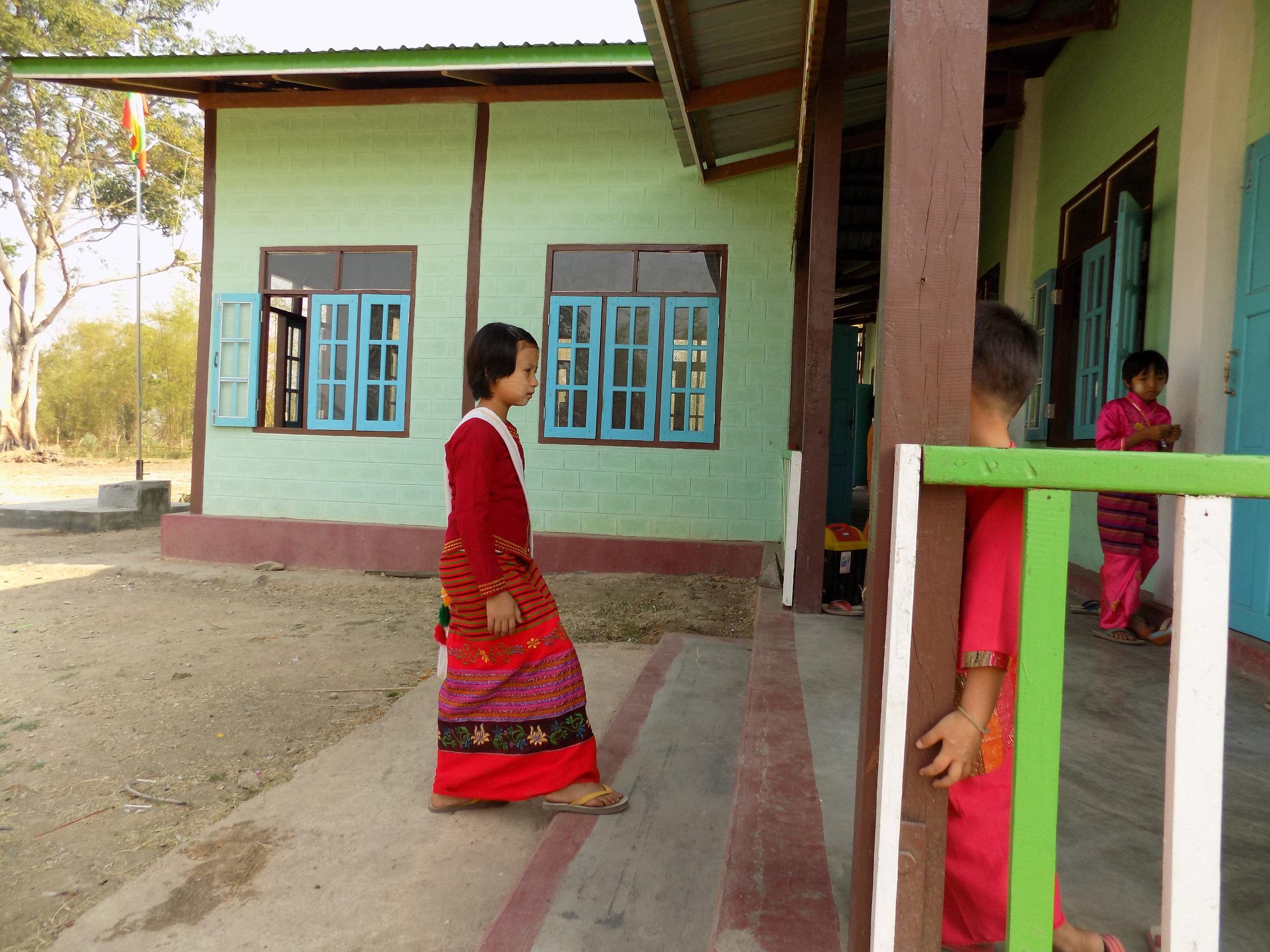 Nung Lao Ngun walks to school.