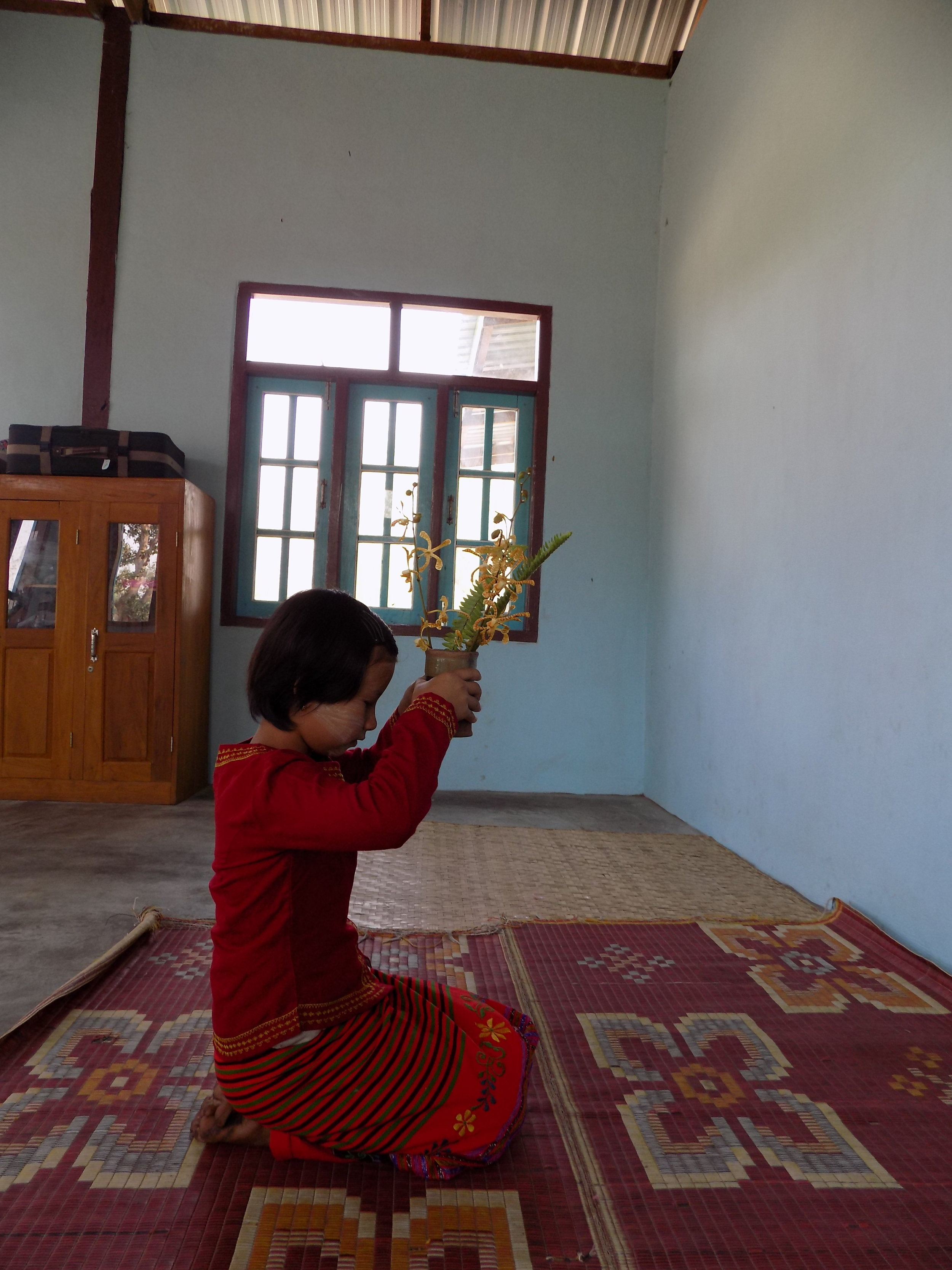 After she gets to school she performs her morning prayers.
