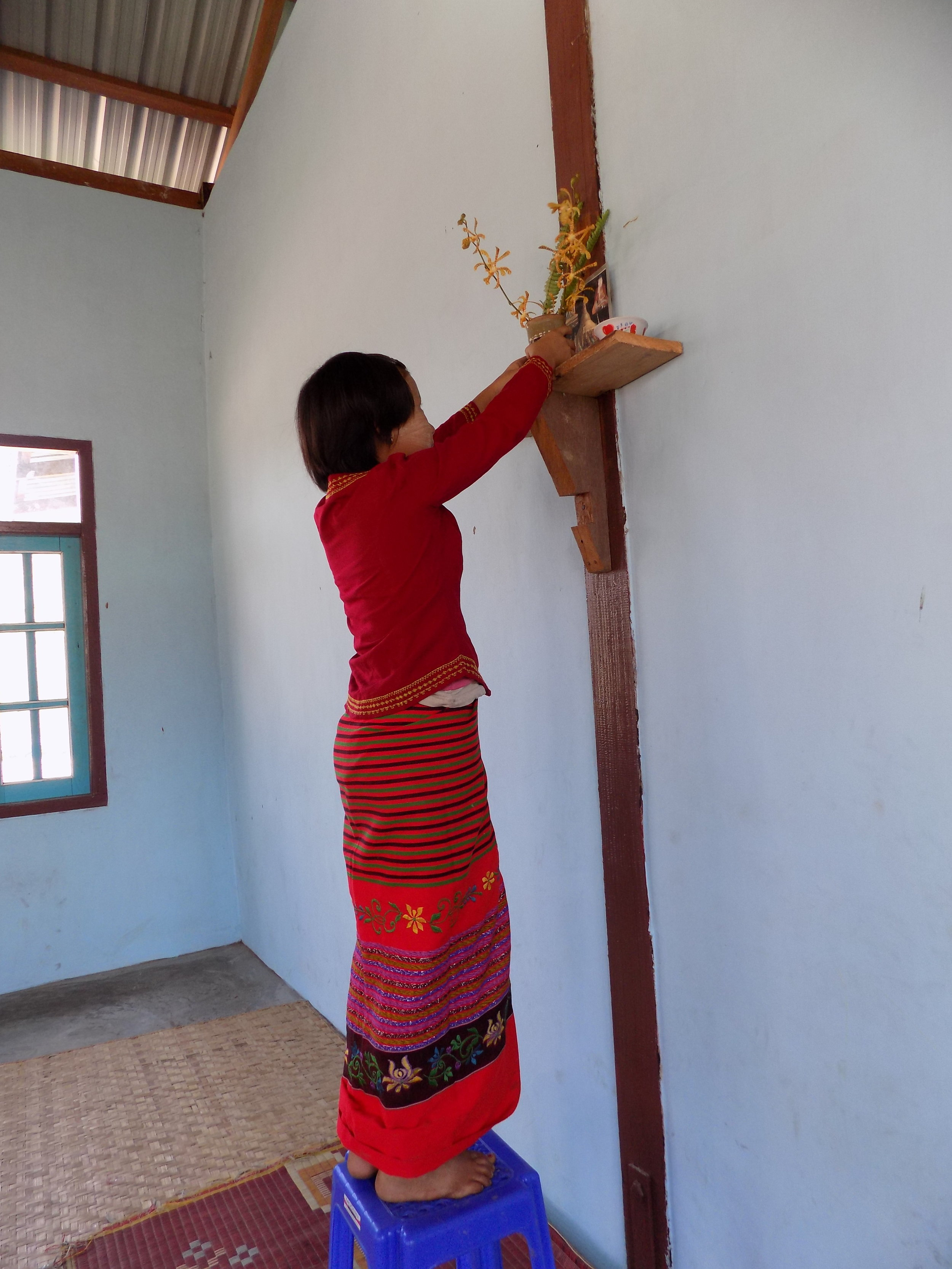 She is Buddhist and prepares flowers for the altar.