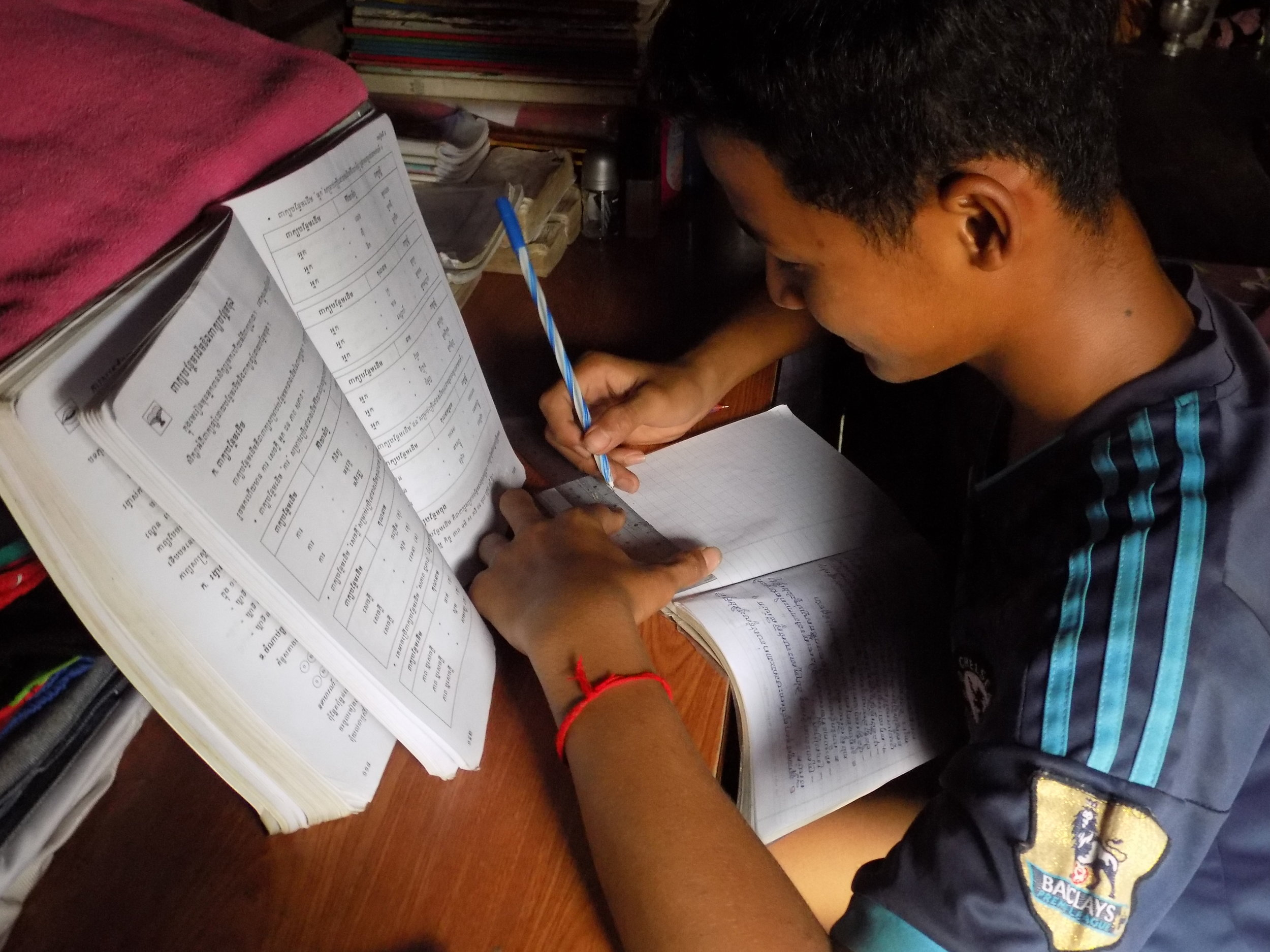 Before he goes to bed, Narak does his homework.