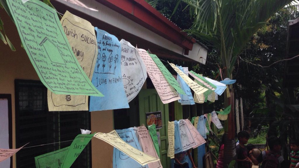 At the start of the New Year, certain Buddhist monks hang new prayer flags to spread positive energy over the land via the wind. Students made their own wishes for their families and communities on these simple flags–an homage to the beautiful flags hung on the mountains of Tibet!