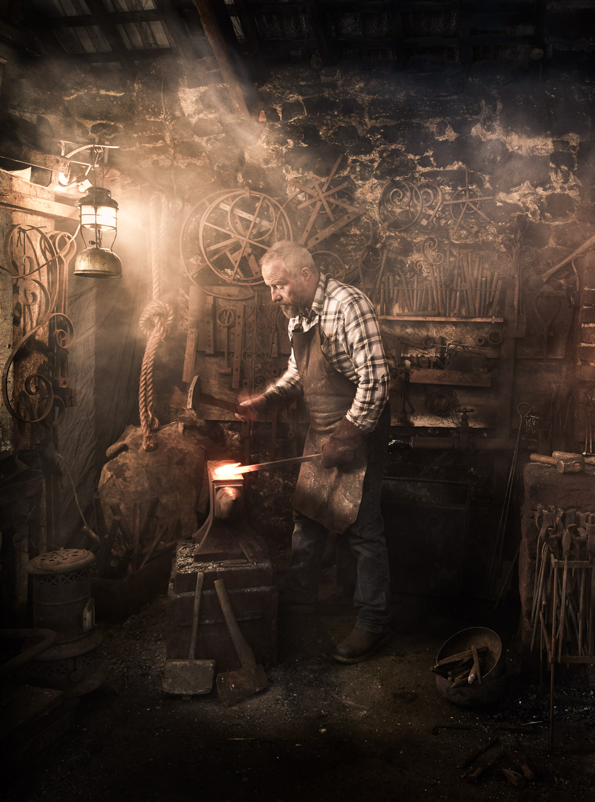 Greg Abel / Blacksmith / Moretonhampstead - One of just a handful of blacksmiths left on Dartmoor, Greg Abel works in a 150-year-old stone forge, where vintage farm and farriers' tools, made by previous smithies, still hang from the rafters. Greg uses traditional coal in the original hearth rather than gas, which is now more commonly used, with hammer and anvil still his main tools. You can drop in to see Greg at work, or book in for a course and learn how to make a fire poker, toasting fork, letter opener, coat hook or barbecue butler