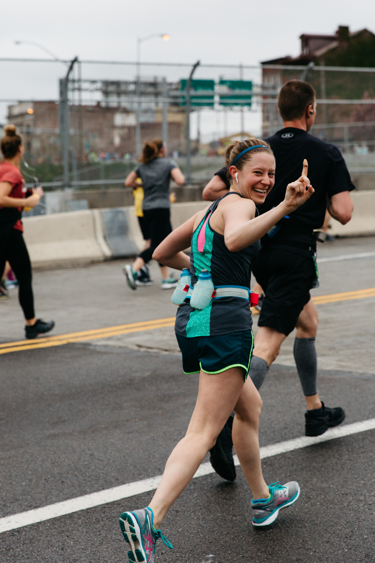 Our friends, Matt and Dana, running the full marathon, at Mile 3.