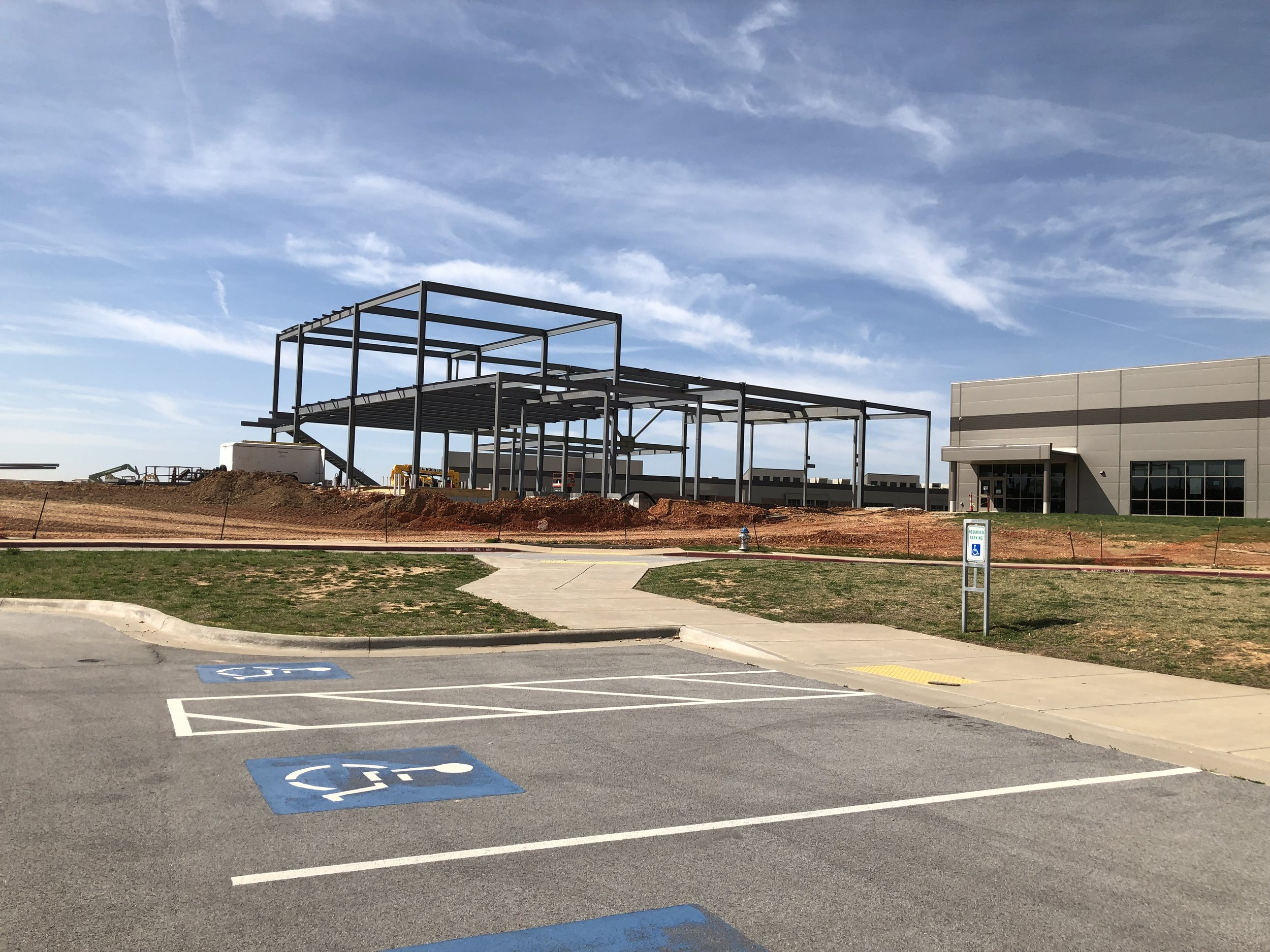 Steel rises for a new expansion to the Don Tyson School of Innovation in Springdale.