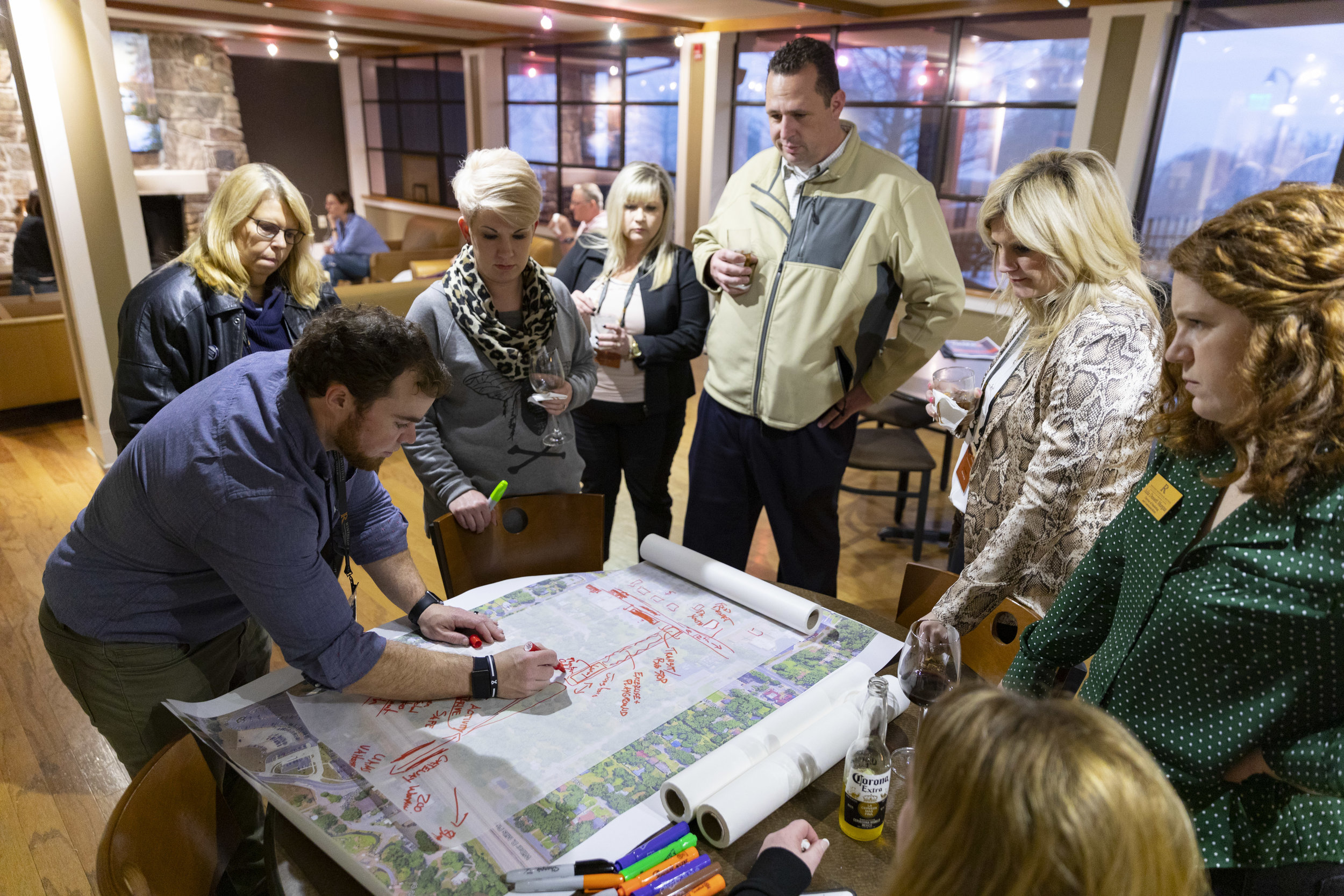 Uncommon Community cohort members collaborate on a project during a recent meeting.