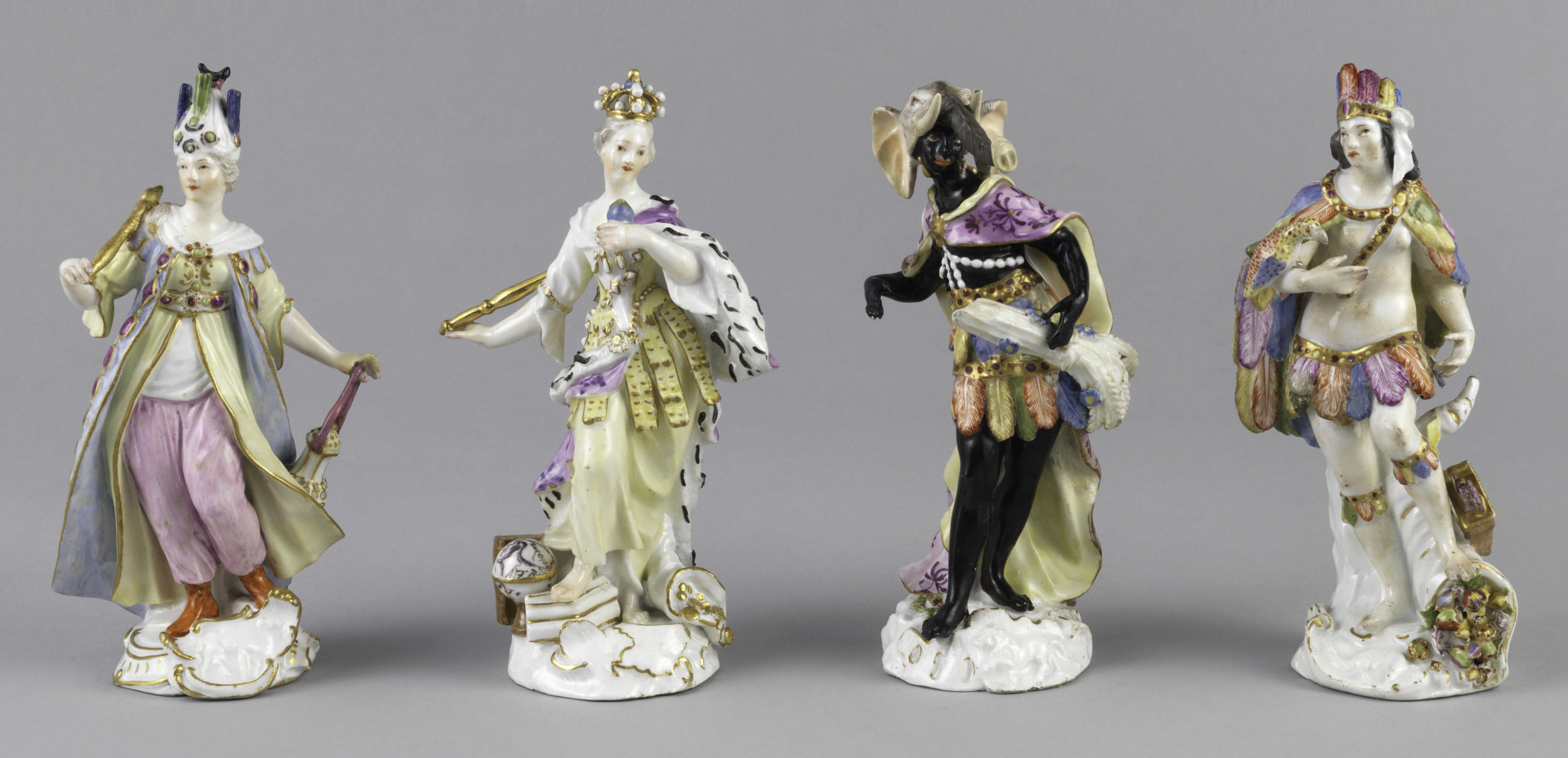The Four Continents and their prejudicial portrayals, rendered in porcelain.
