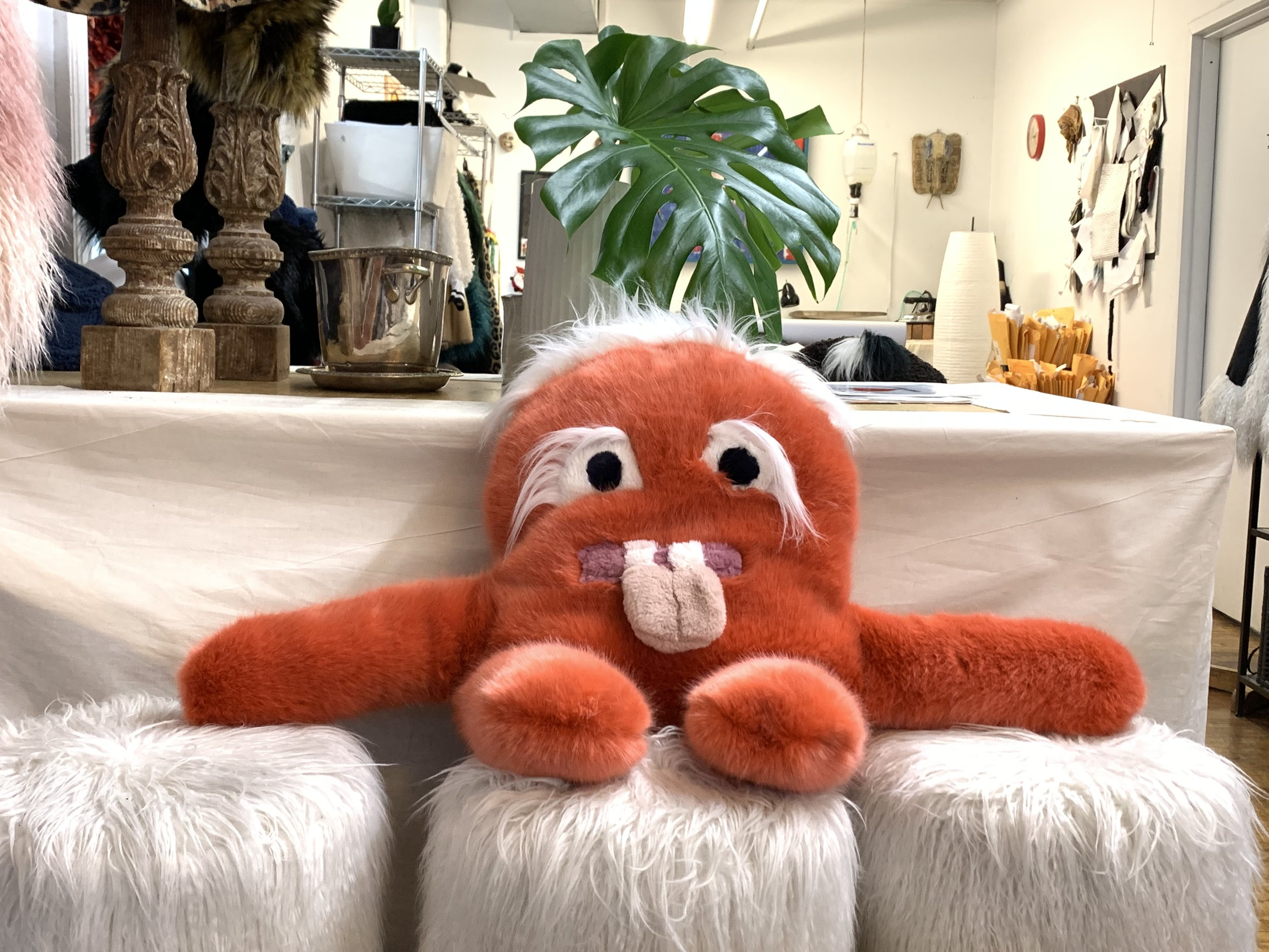 House of Fluff turns their excess materials into plush pals called Scrappys. Here one lounges at the brand's New York City atelier.