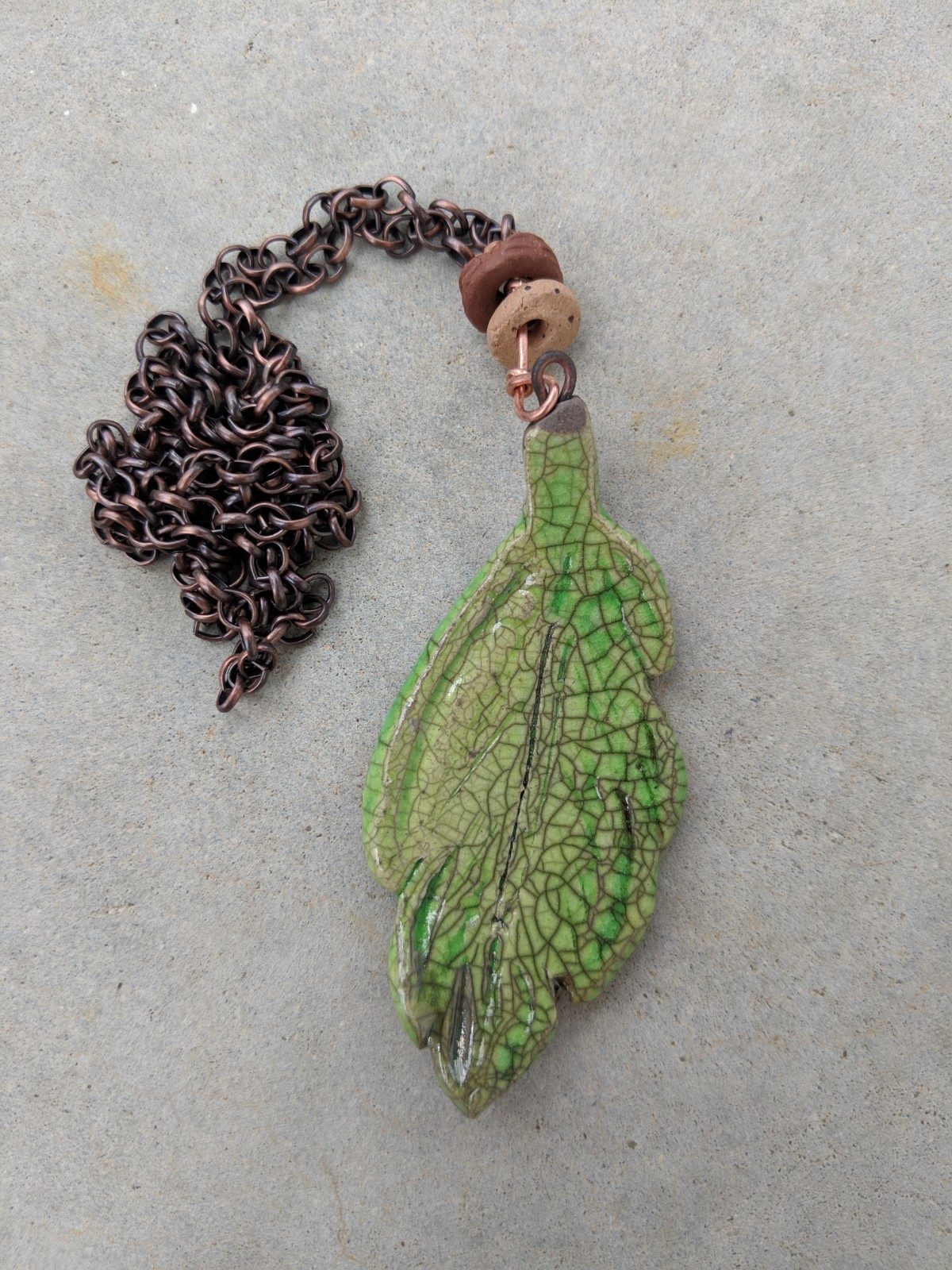 Lime green glaze leaf pendant