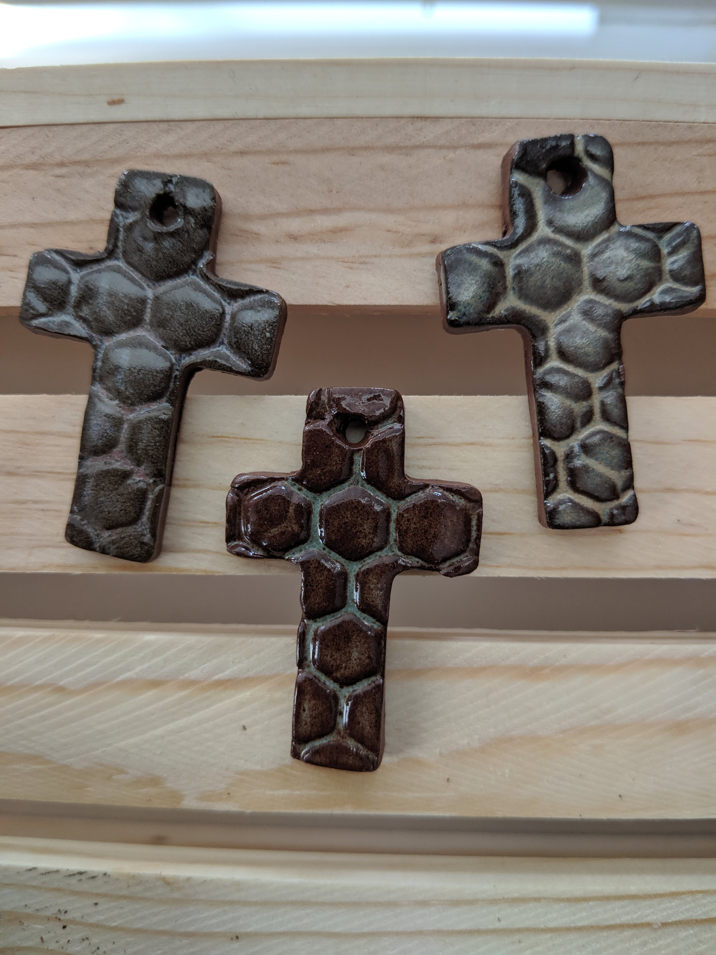 Small crosses with the honeycomb texture and glaze. These can be used for prayer beads and/or necklaces.