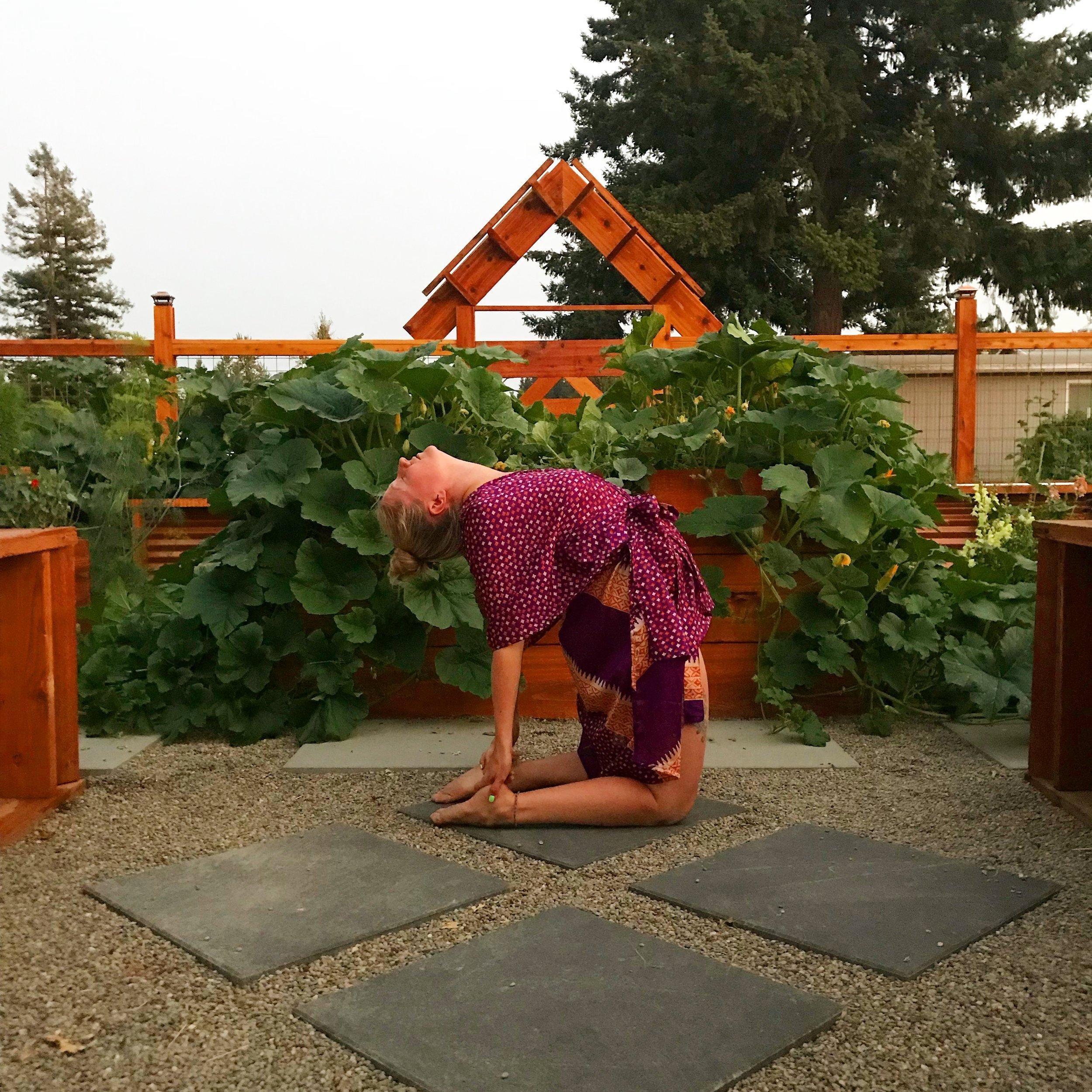 Brit practicing yoga inside the BZen Wellness garden.