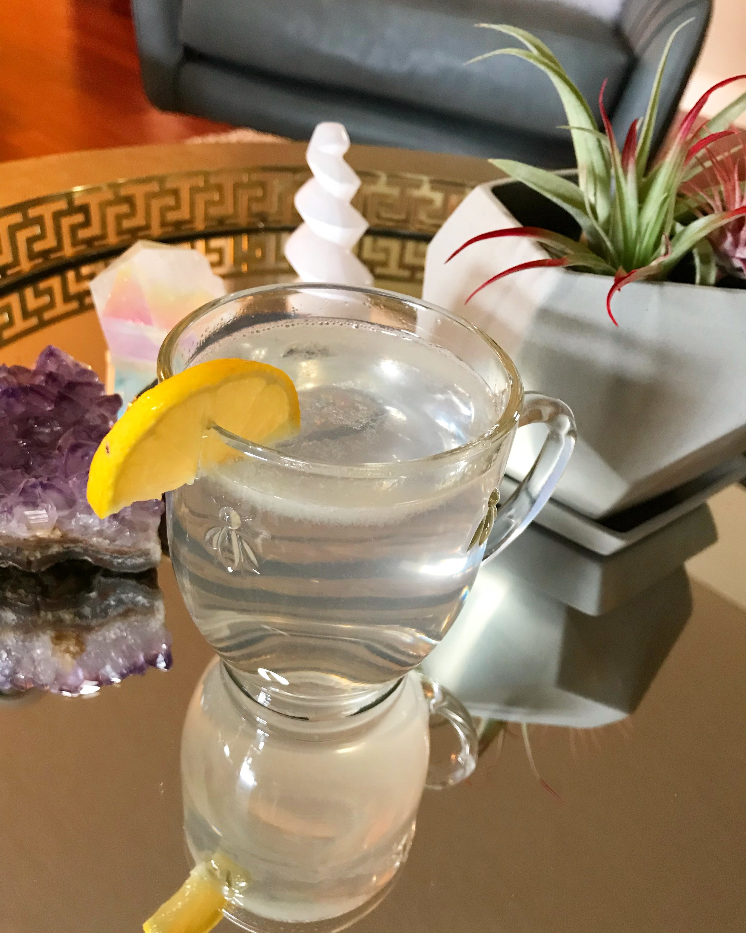 Hot water with fresh squeezed lemon and a dash of pink Himalayan sea salt is a staple in our household every morning.