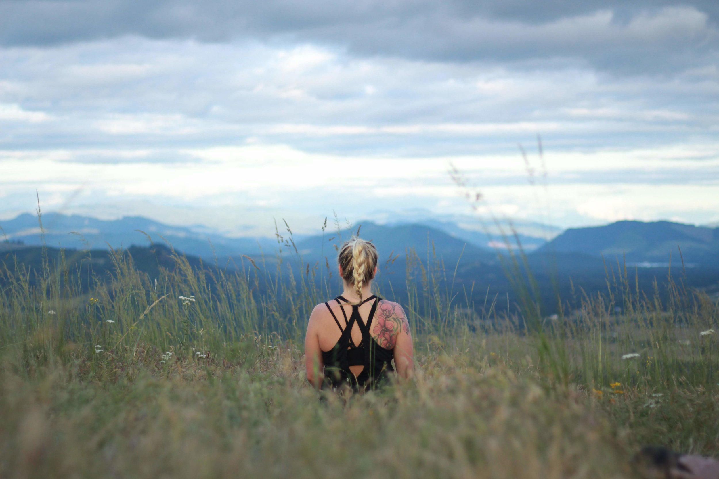 Brit meditating at the top of Mt. Pisgah during a yoga hike that she lead.
