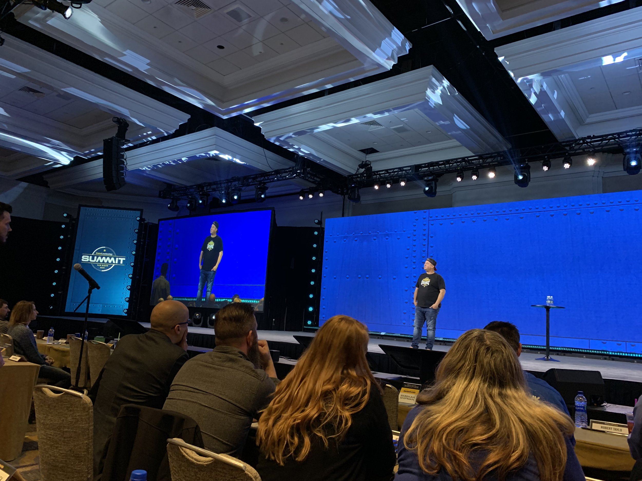 Trav Boersma on the Entreleadership stage presenting all about Dutch Bros., the culture, and it's history.
