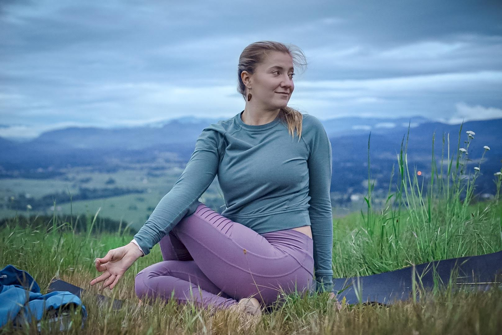 Brit practicing ardha matsyendrasana on top of Mt. Pisgah. Twists are excellent for digestion and internal organ function!