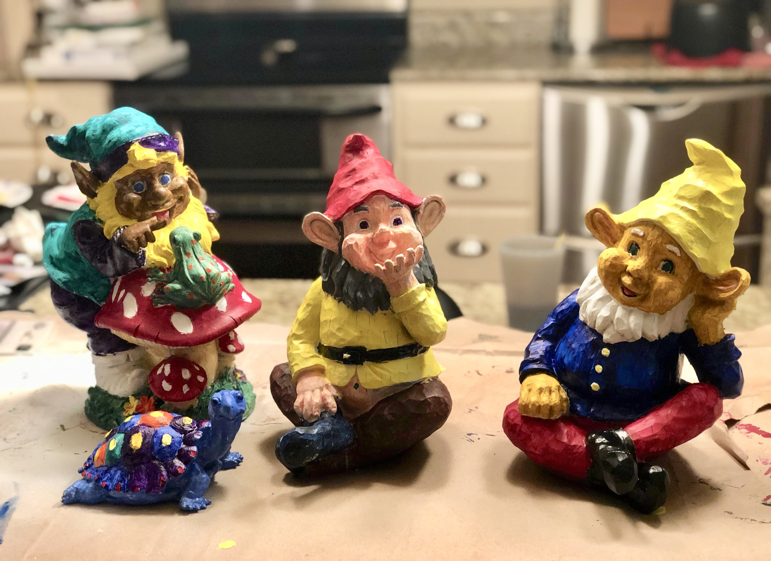 "Tormund the Turtle and our Garden Gnomes: Carl, Scabs, and ""Colonel"" Mustard."