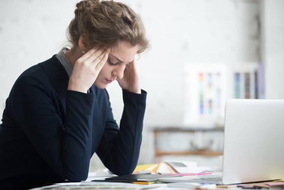 woman-stressed-at-work_gettyimages-524148692_large.jpg