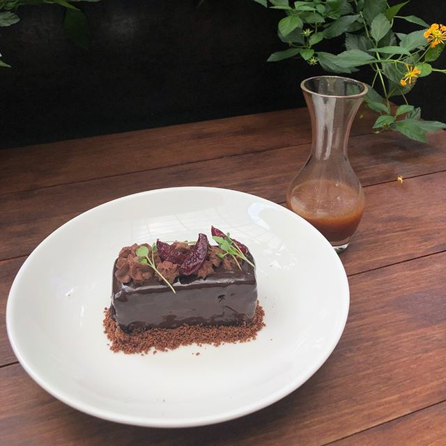 If you haven't been in to try Chef Clair's Dark Chocolate Cake, with a sweet cream filling and brown butter caramel, you've been missing out!  #Dessert #Chocolate #PastryChef #Do512 #AustinEats