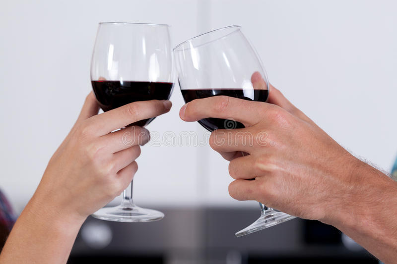 couple-s-hands-holding-glasses-wine-close-up-47403048.jpg