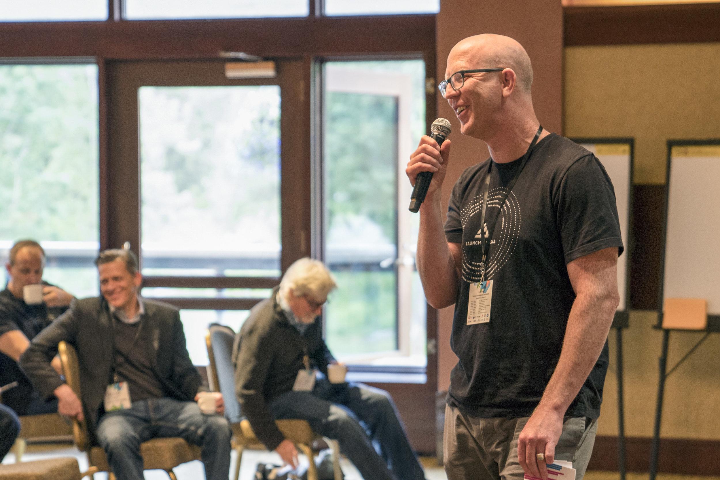 Isaac Vanderburg, managing director of Launch Alaska, speaks at the Energize Alaska Summit in Girdwood in 2018. (Photo courtesy of Launch Alaska)