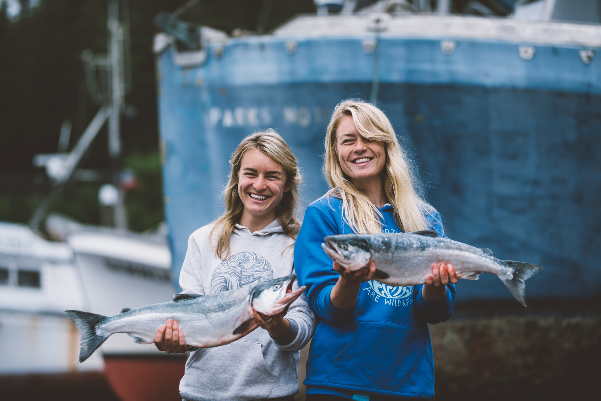Claire Neaton and Emma Teal Laukitis — also known as the Salmon Sisters — started the Give Fish Project in 2016, an initiative that sets aside 1 percent of sales to buy wild Alaskan seafood that is donated to the Food Bank of Alaska. (Photo courtesy of the Salmon Sisters)
