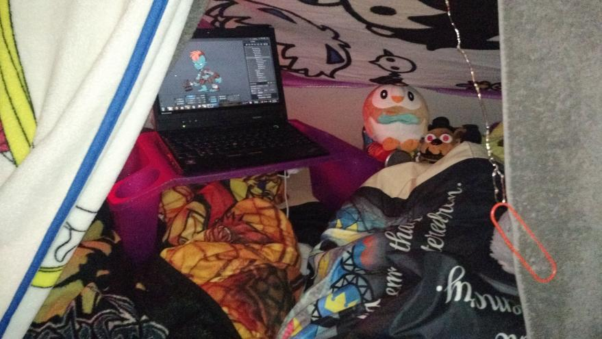 My literal cave, the comfiest of workspaces.