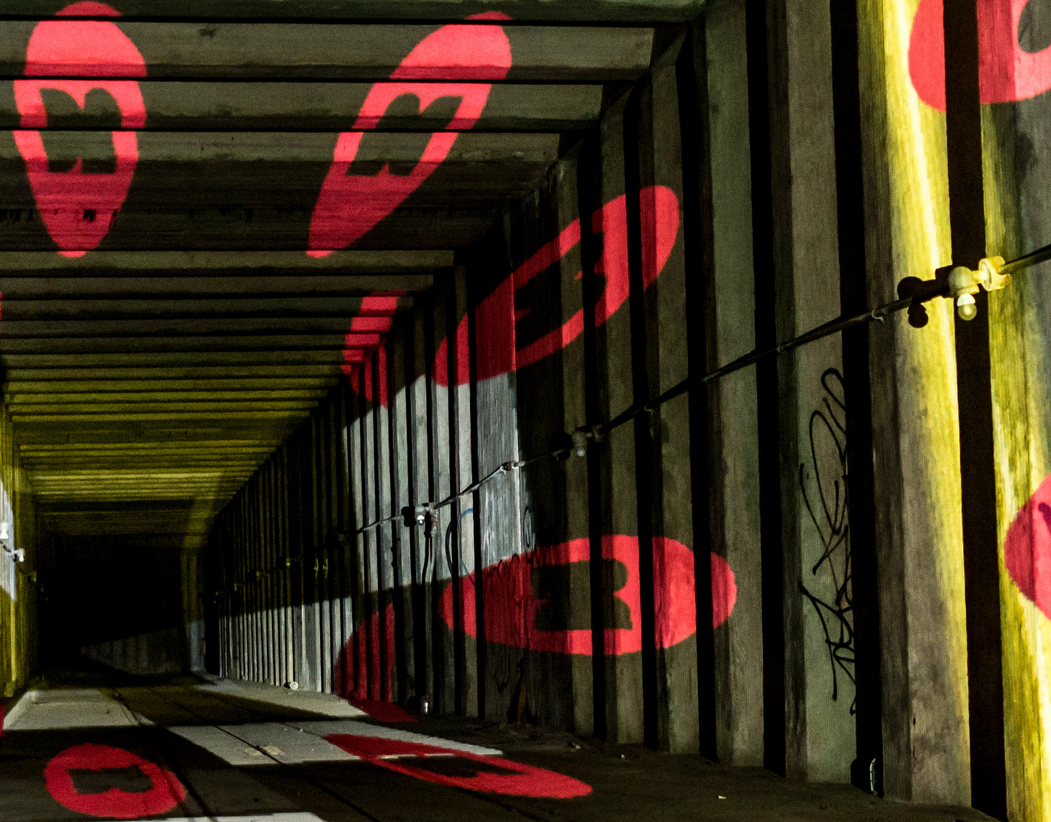 Dynamic video projections down the tunnel, featuring Dupont Underground logos. Photo:   Victoria Pickering  /CC BY-NC-ND 2.0