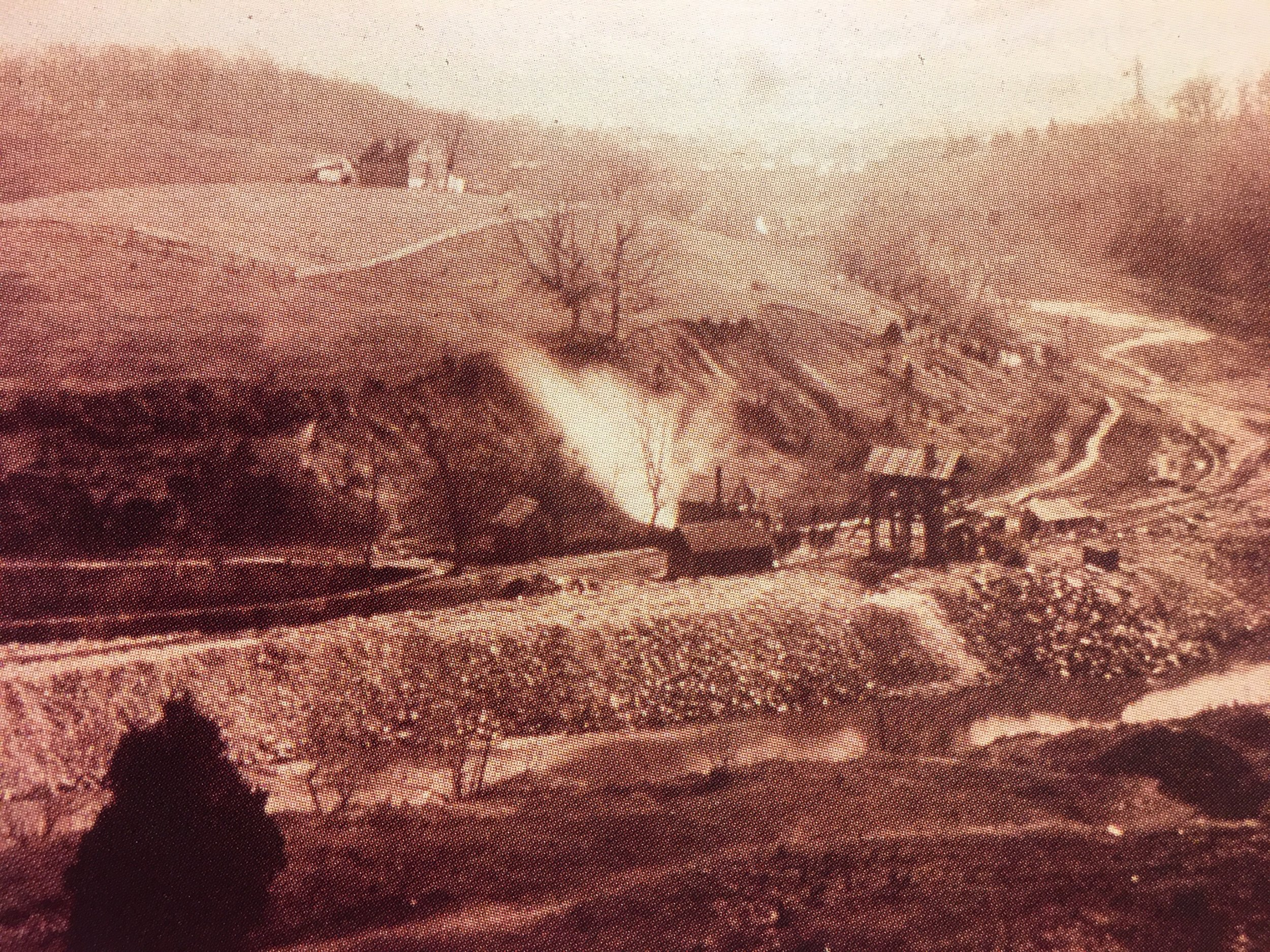 Smoke and dust rises from the Rock Creek shaft after blasting. Photo:  Army Corps of Engineers /Public Domain