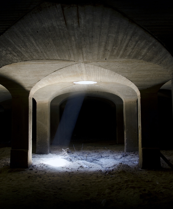 The vaulted ceiling is punctuated by hundreds of manholes. When the filter plant was in regular operation, Aqueduct employees would dump fresh sand down through the holes, before carefully spreading it out in an even coating. Photo:   Chris Wieland  /CC BY-NC 2.0