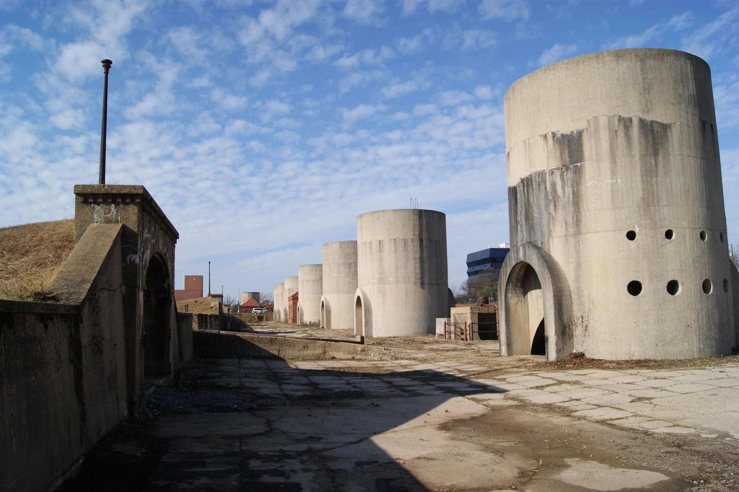 Twenty unreinforced concrete silos dot the reservoir grounds. The drip drip of water, and ever-present patches of sand still strongly evoke the filtration plant's operational days. Photo: Elliot Carter