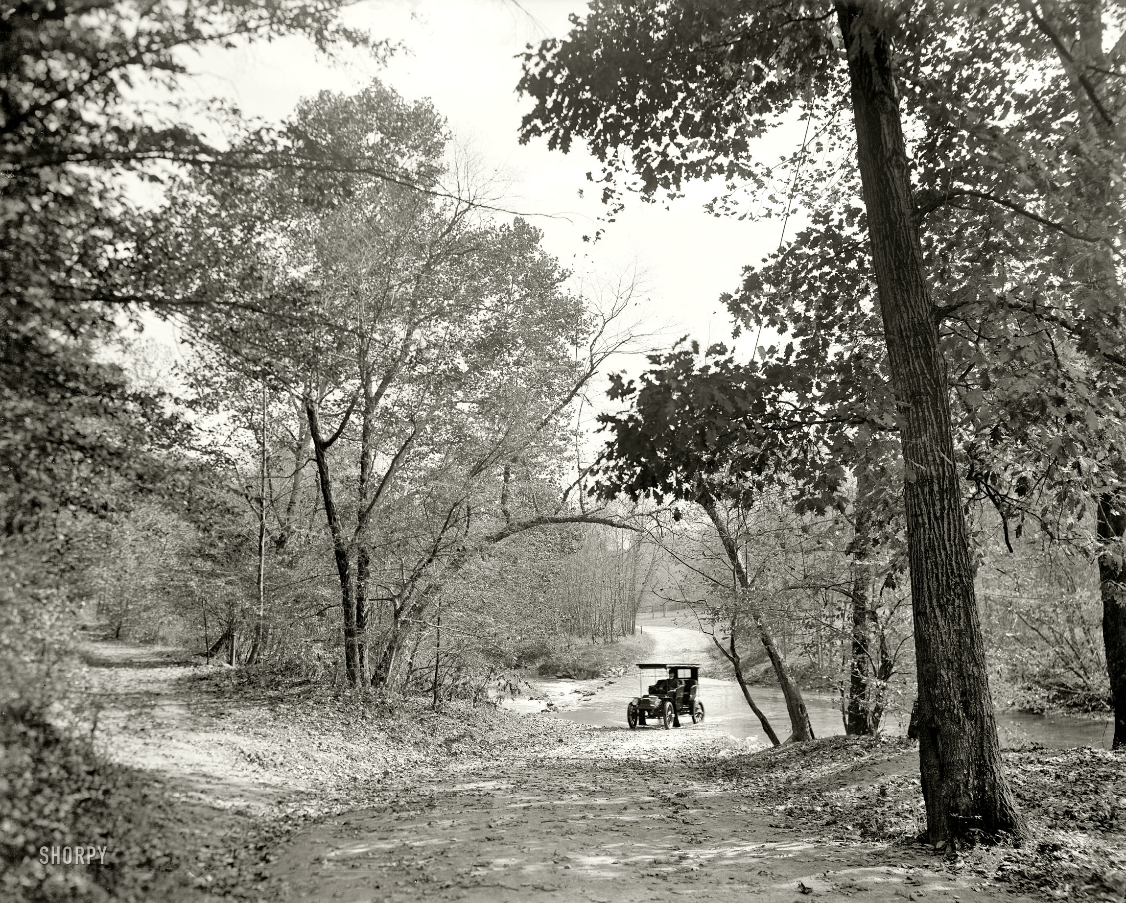 Before construction of the Zoo tunnel, motorists crossed Rock Creek at shallow fords as seen here in 1906.   Detroit Publishing Company  /Public Domain