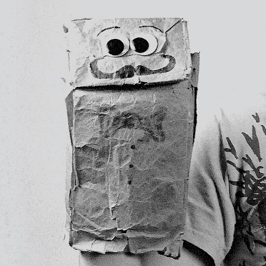 "Feature Alert! This Wednesday (3/27) @MilkweedPoetry Presents: the Poems of Vaschel. Vaschel Fischer-Kypers is a published poet, accomplished karaoke performer, and the subject of @kkypers documentary, ""Vaschel: Portrait of a Paper Bag"". He is also a paper bag. 📷: @nataliemuffin"