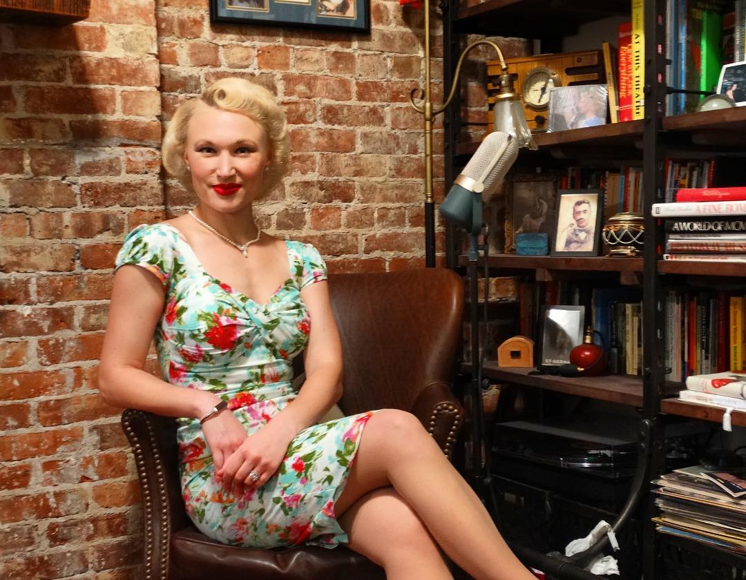 """I love this flower wiggle dress from  Stop Staring  - It is so feminine and flattering for any shape. Dresses in the 40s and 50s showed off a gal's curves and made her look great. Can you spy our latest album, """"Swing Around the World"""" in this photo?"""