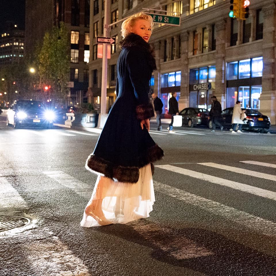 I am always on the go in the big city, but I have my beautiful  Unique Vintage  coat and  Adrianna Papell  dress to keep me glamorously warm!