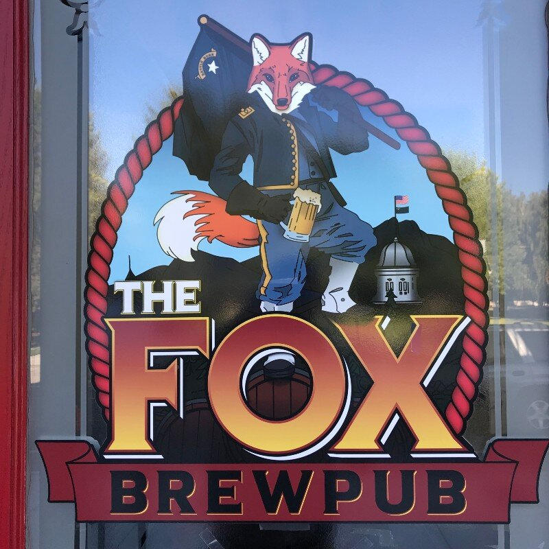 "The Fox looks good with a ""Battle Born"" flag and a mug of frosty goodness... a stout, no doubt. Photo by Bob Moffitt"