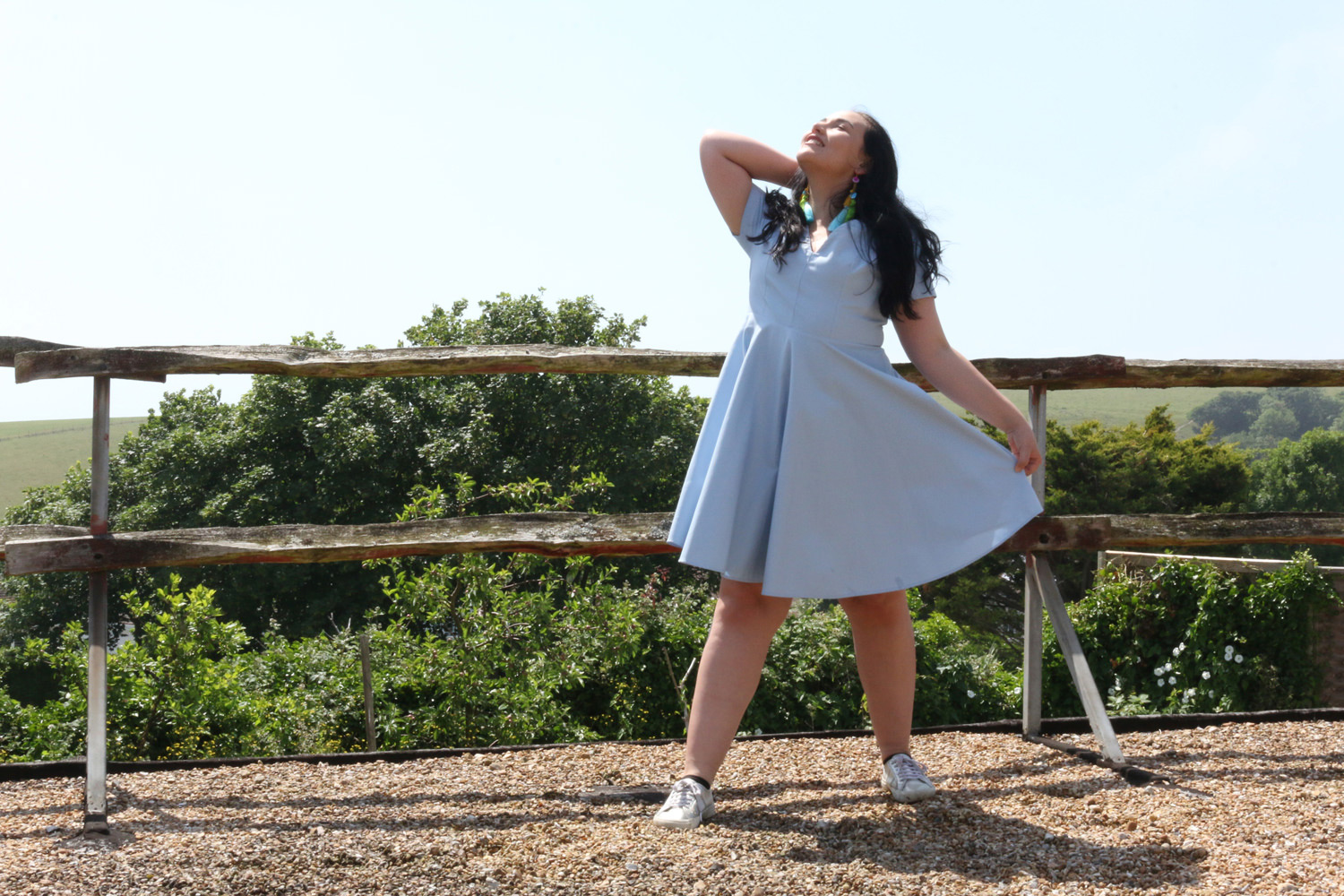 Kitty wears tassel earrings by  Hey Kitsch Kitty  & 'High in the Sky' Amy Dress by  The Emperor's Old Clothes