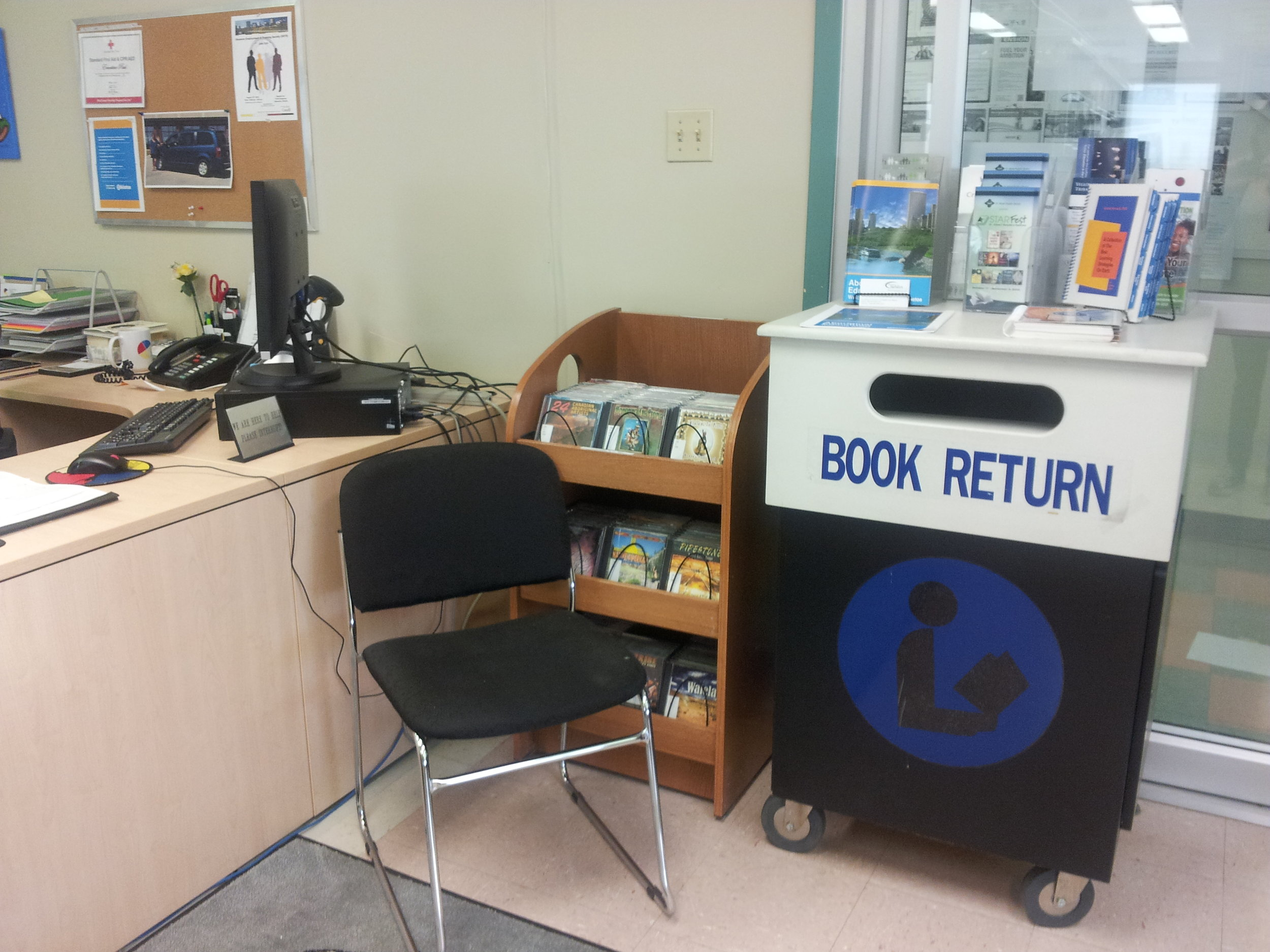 The quaint reference desk where the always kind library support staff, Ernestine greets you as you enter the library.