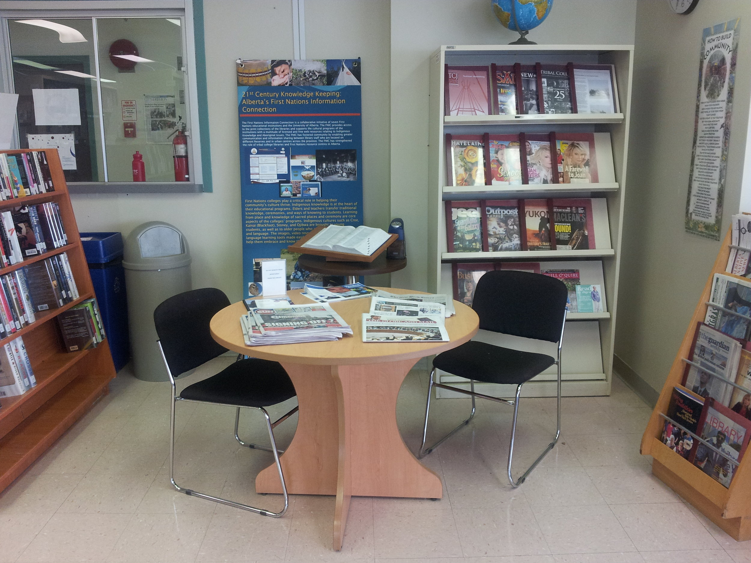 "This is called the ""Reading Corner"". It's a small space where patrons can enjoy their periodicals, namely newspapers and magazines. On Mondays, the library hosts ""Coffee Monday"" where free coffee is offered to students and staff in the ""Reading Corner""."